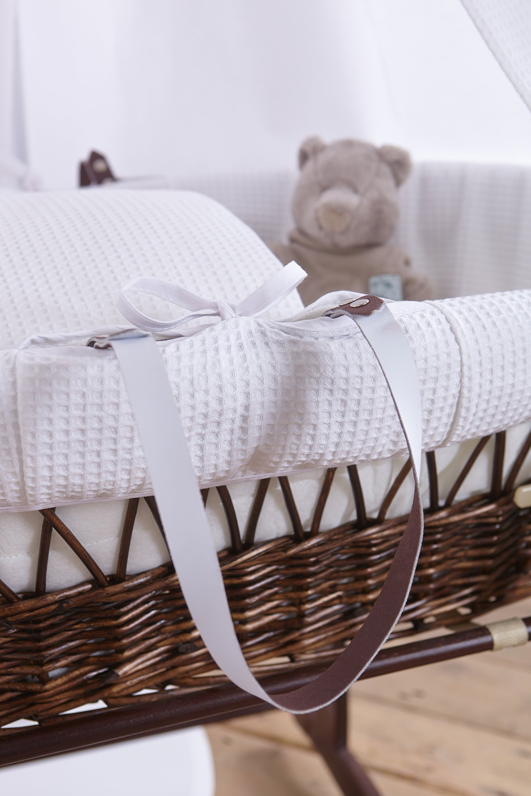 6-Piece White Waffle Dark Wicker Moses Basket Starter Set  Made from 100% super soft Waffle cotton fabric Lightweight cotton drape edged with soft Waffle cotton to match the dressing, with freestanding rod to place next to the Moses basket Comes complete with matching stand, padded liner, delicately embroidered 2.0 tog, reversible coverlet and mattress. 5