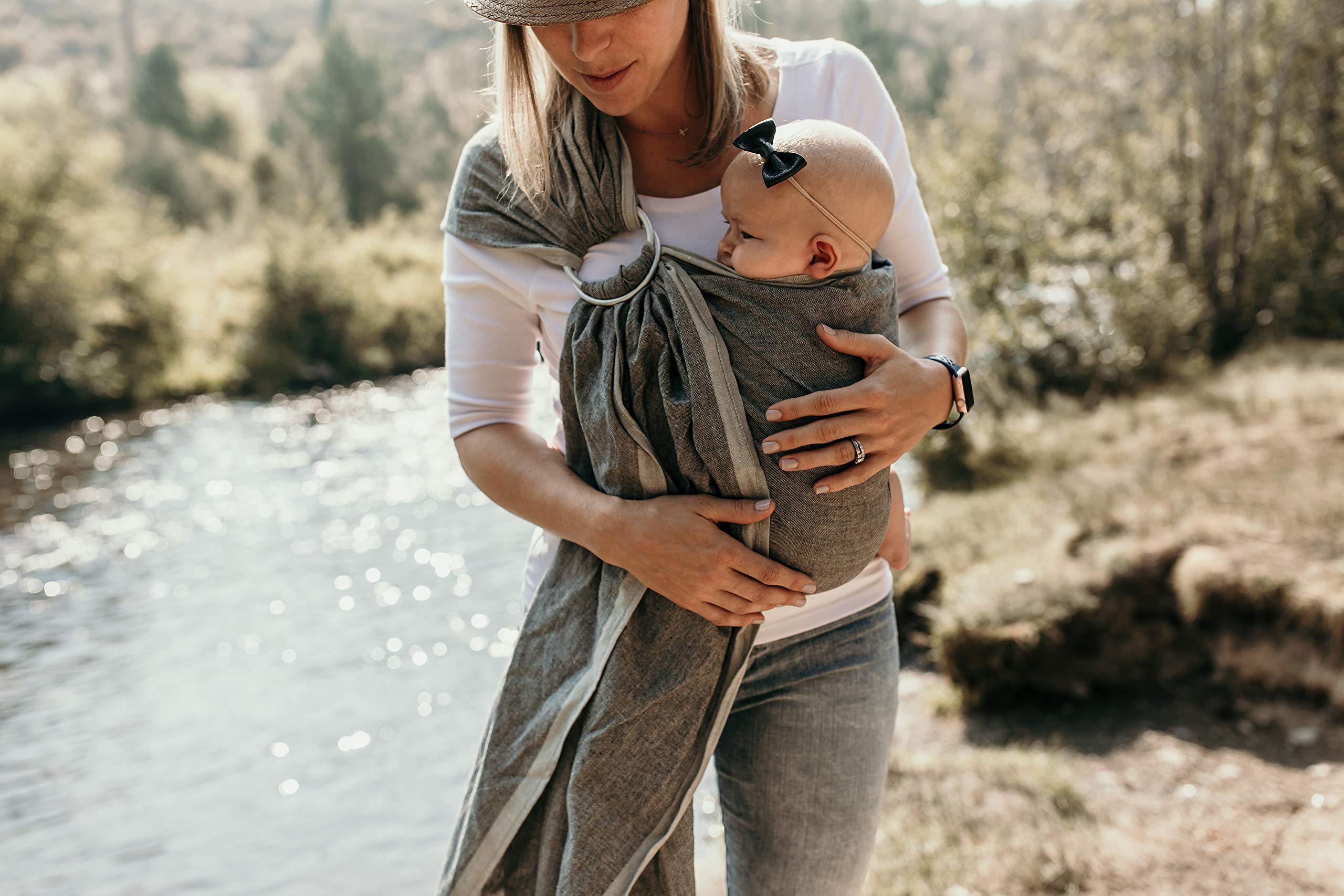 Hip Baby Wrap Ring Sling Baby Carrier for Infants and Toddlers (Midnight) Hip Baby Wrap Eco-Friendly - Made with beautiful 100% cotton, hand-loomed, breathable fabric and with top quality aluminum SlingRings. For babies 8 - 35 lbs. Fair trade and individually handwoven with eco-friendly non- toxic dyes in India so each wrap is beautiful and unique. Our lightweight fabric makes the Hip Baby Wrap cooler for baby and easy to manipulate. Superior ergonomic design helps distribute baby's weight evenly and comfortably across caregiver's body, relieving the shoulders and neck from unnecessary strain. Great for nursing on-the-go and as a nursing cover. Enhances parent-child bonding and child development. 2