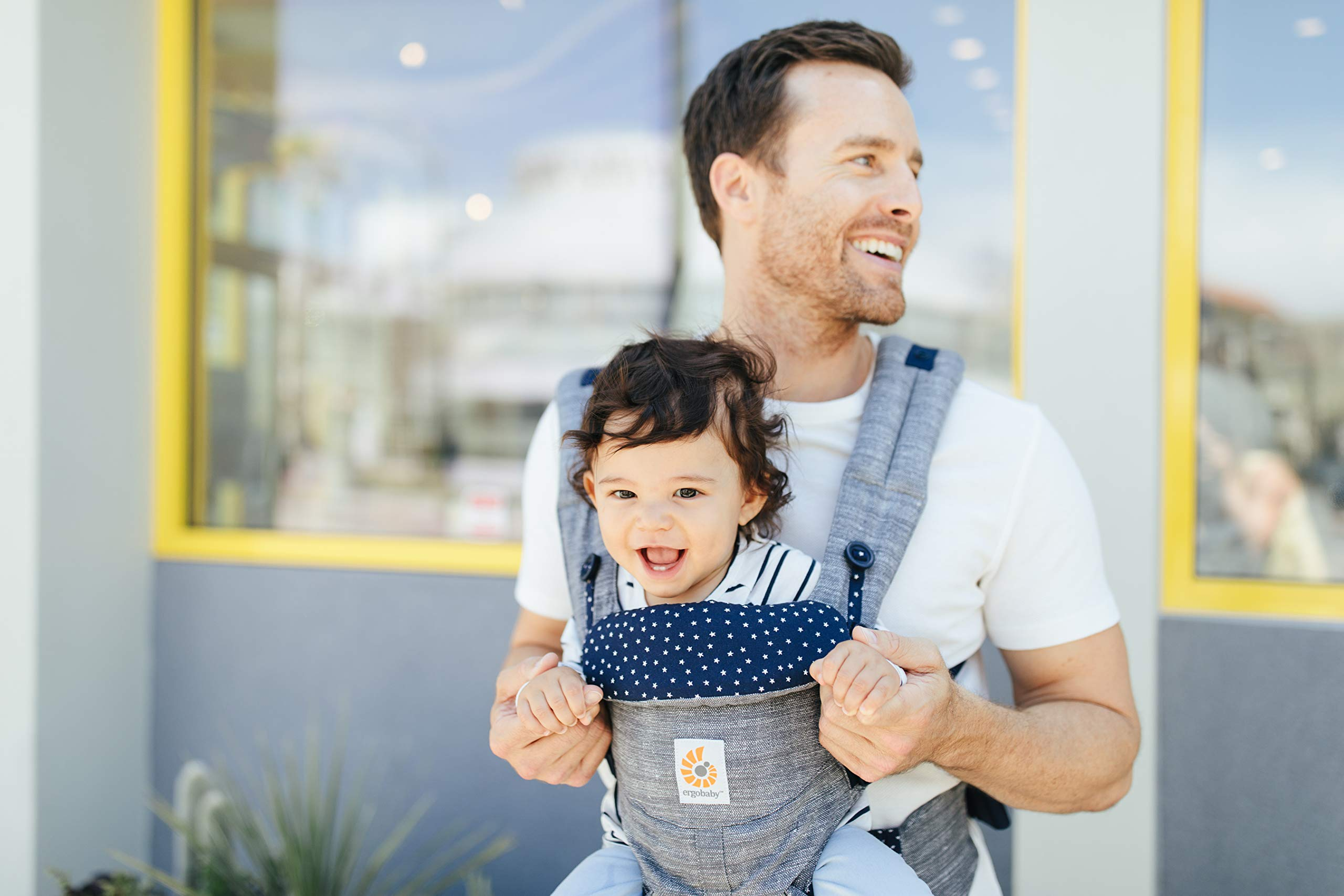 ERGObaby Baby Carrier for Newborn to Toddler, 4-Position Omni 360 Star Dust, Ergonomic Child Carrier Backpack Ergobaby Baby carrier with 4 ergonomic wearing positions: parent facing, on the back, on the hips and on the front facing outwards. Adapts to baby's growth: Infant baby carrier newborn to toddler (7-33 lbs./ 3.2 to 20 kg), no infant insert needed. Tuck-away baby hood for sun protection (UPF 50+) and privacy. NEW - Maximum comfort for parent: Longwear comfort with lumbar support waistbelt and extra cushioned shoulder straps. 5