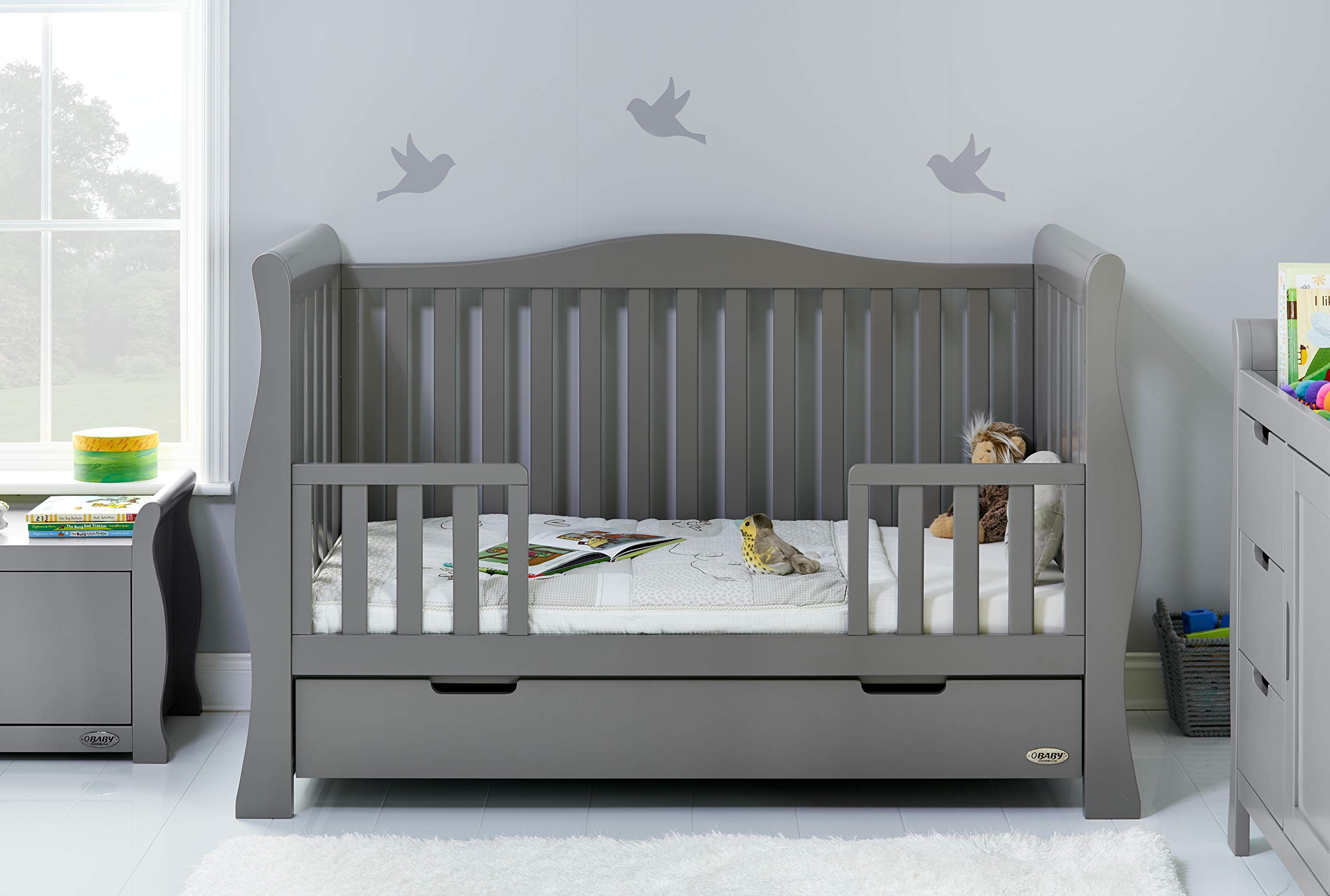 Obaby Stamford Sleigh Luxe Cot Bed - Taupe Grey Obaby Adjustable 3 position mattress height Bed ends split to transforms into toddler bed Includes matching under drawer for storage 2