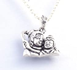 This pendant features Lord Shiva and Goddess Parvati, it symbolises parents and couple love Couples pendant. (925 Sterling Silver)