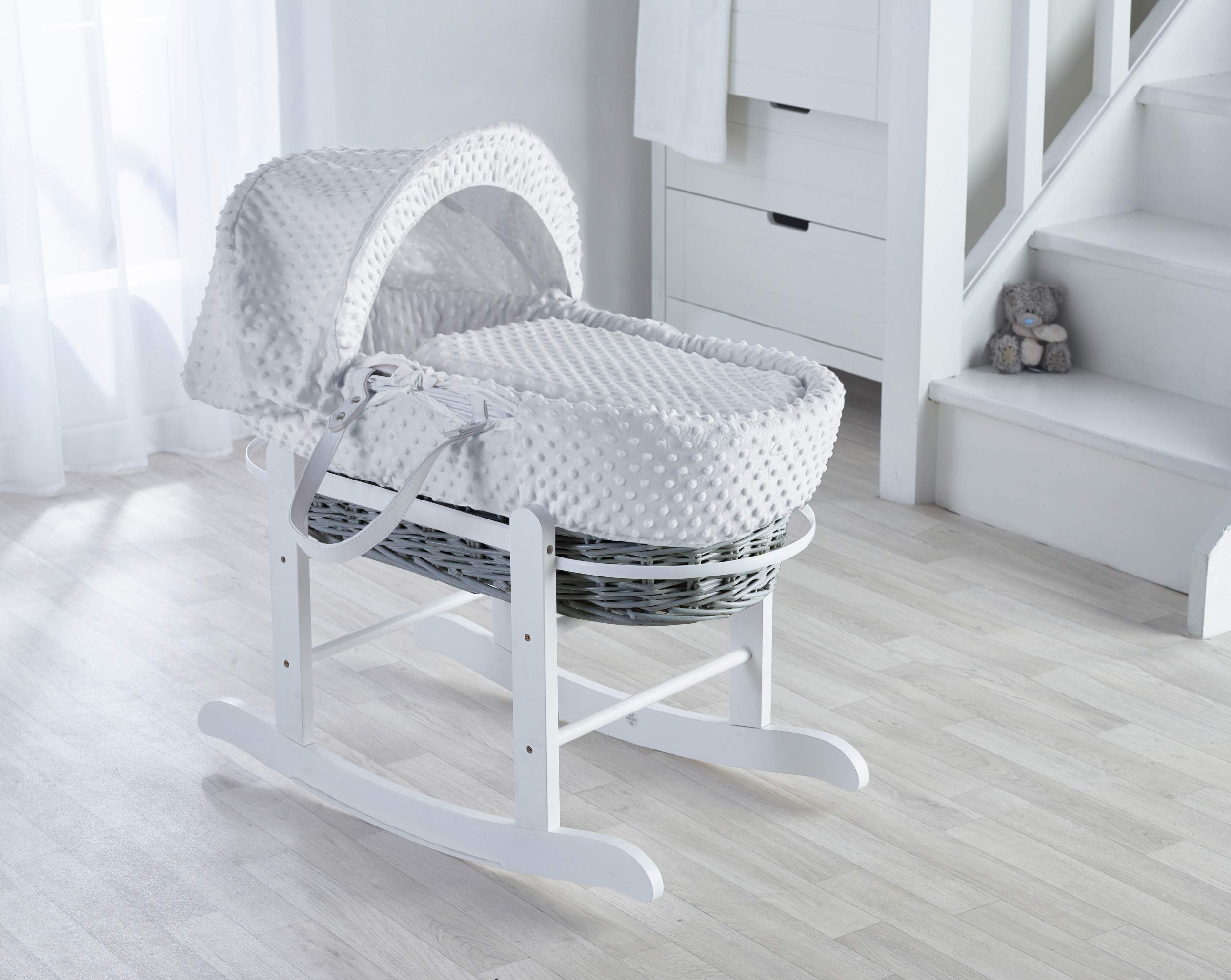 White Dimple on Grey Wicker Padded Moses Basket & Deluxe White Rocking Stand. Elegant Baby Suitable from newborn for up to 9kg, this Moses Basket uses Easy-care Poly Cotton with a soft padding surround Suitable from newborn to 9 months It also includes a comfortable mattress and an adjustable hood perfect to create a cosy sleeping space for your precious little one 1