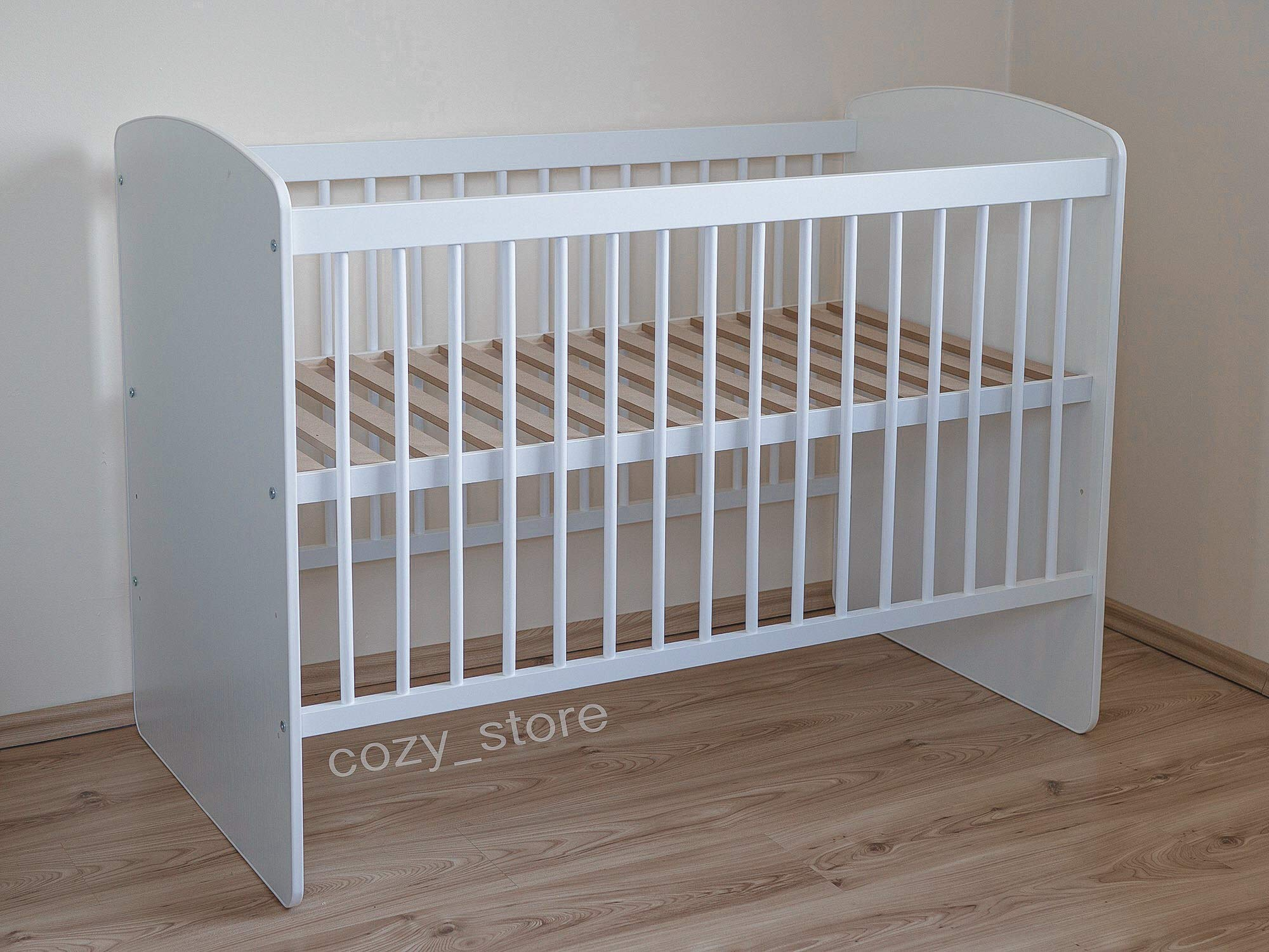 SOCOZY®   White Solid Pine Wood Baby Cot Bed I Free Healthy Coconut&BUCKWHEAT Mattress I Bed for Baby   3 Mattress Positions   ECO Paint   Minimalistic   120x60 SOCOZY ✔ HEALTH your growing child is the most important for us - The bed is made of ecological board and pine wood and the cot is covered with non-toxic lacquers ✔ ENJOY the view of the child playing in the cot and have a moment to yourself - as mom you deserve it more than anyone else ✔ GIVE YOUR CHILD a peaceful and helathy sleep - Coconut mat provides a flat, hard but also elastic support for the body while sleeping, perfect air circulation and humidity control. The mat is ecological. 4