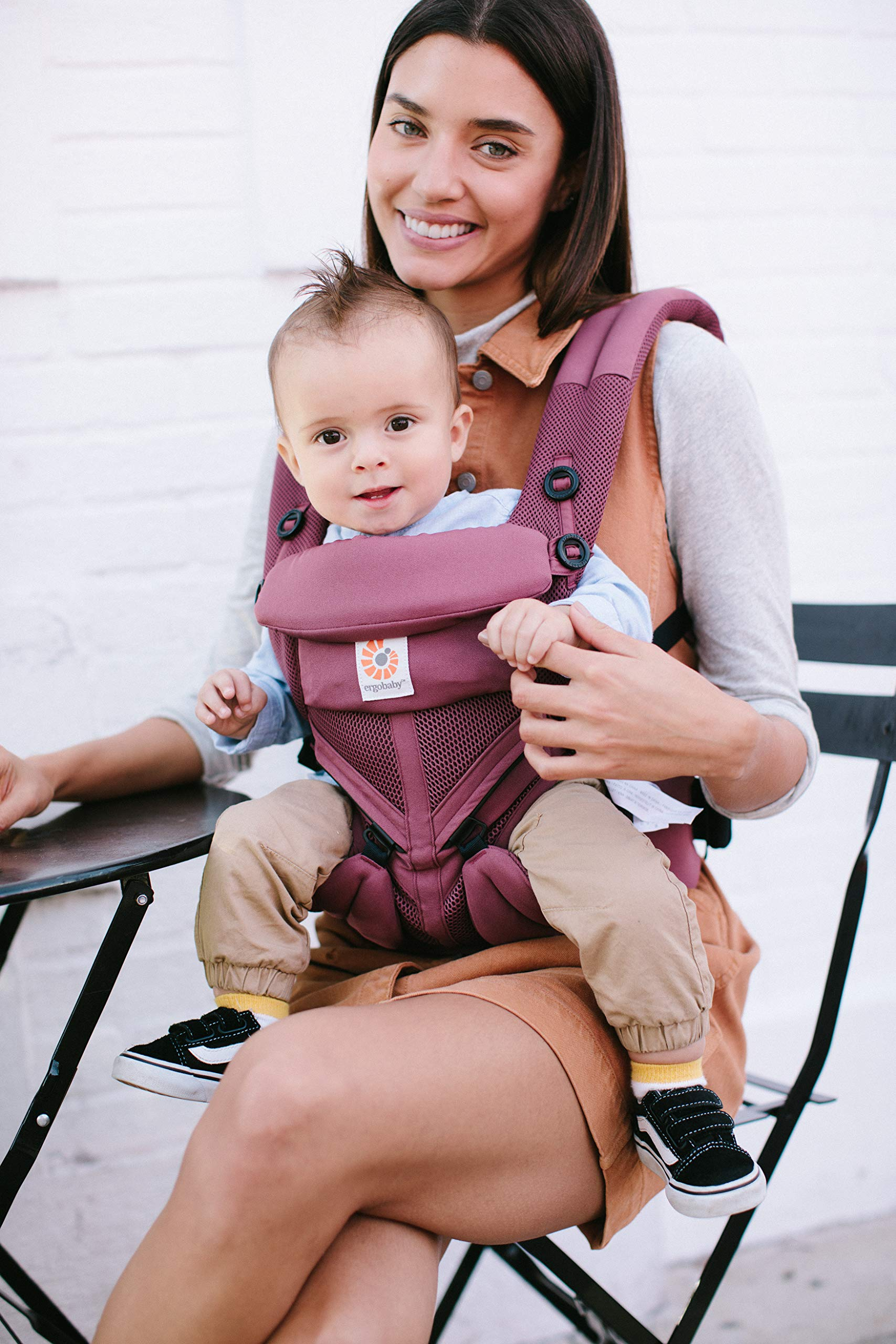 Ergobaby Baby Carrier for Newborn to Toddler, 4-Position Omni 360 Cool Air Plum, Breathable Ergonomic Child Carrier & Backpack Ergobaby BABY CARRIER FOR NEWBORN - Adapts to your growing baby from birth to toddler (7-45lbs). 4 carry positions: front-inward, back, hip, and front-outward. A Baby hood for sun protection (UPF 50+) & privacy for sleeping or breastfeeding is included. COMFORT - Exceptional lower back comfort with padded lumbar support waist belt & extra padded shoulder straps with the option to wear 2 ways: crossed or backpack style. Waist belt can be worn high or low to maximize comfort. COOL & BREATHABLE - Our Cool Air Mesh baby carriers are made with soft and durable mesh fabric that provides our renowned ergonomic support for baby while allowing for ultimate breathability and airflow 3