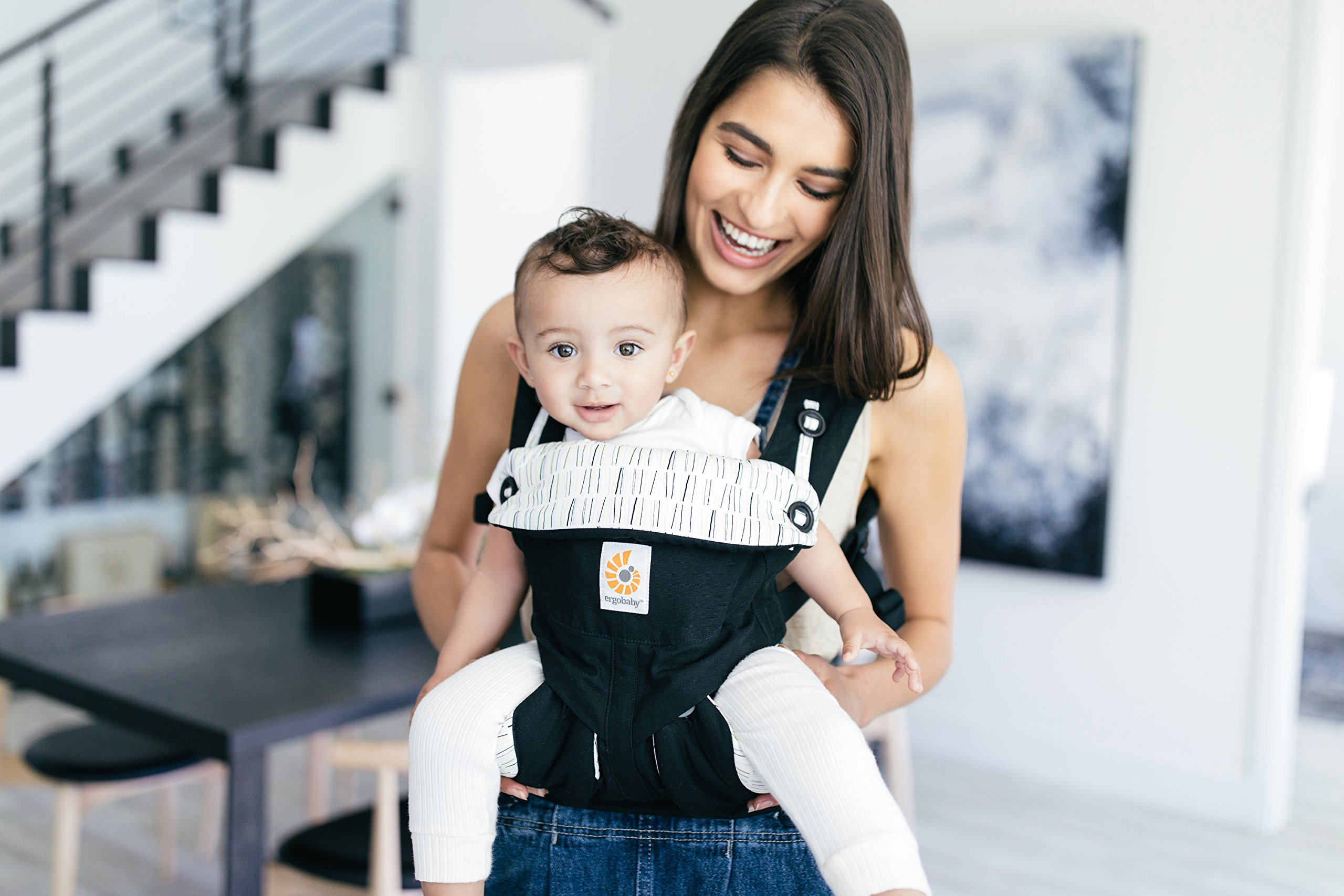Ergobaby Baby Carrier up to 3 Years (12-45 lbs) 360 Downtown Design, 4 Ergonomic Carry Positions, Front Facing Baby Carrier, Child Carrier Backpack Ergobaby Ergonomic baby carrier with 4 ergonomic carry positions: front-inward, back, hip, and front-outward. The carrier is suitable for babies and toddlers weighing 5.5-20 kg (12-45 lbs), and can be used as a back carrier. Also with insert for newborn babies weighing 3.2-5.5 kg (7-12 lbs), sold separately. NEW - The waistbelt with lumbar support can be worn a little higher or lower to support the lower back and provide optimal comfort, and has adjustable padded shoulder straps. The carrier is suitable for men and women. Maximum baby comfort - The structured bucket seat supports the correct frog-leg position for the baby. The carrier also has a padded, foldable head and neck support. Ergobaby carriers are a new take on the usual baby sling. 6