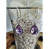 Pendiente de Plata y cristal de roca en color lila con un diseño elegante.
