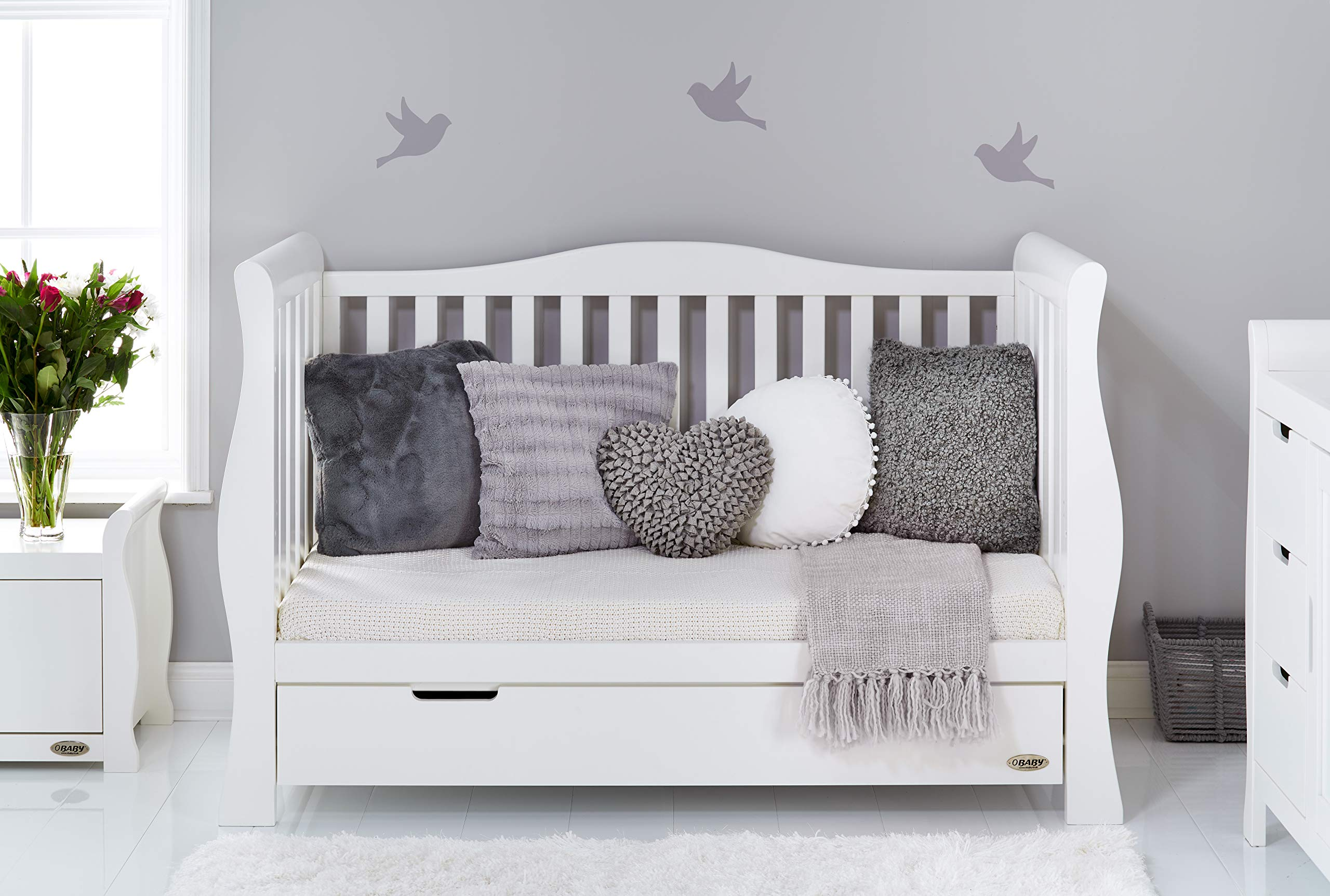 Obaby Stamford Sleigh Luxe Cot Bed - White Obaby Adjustable 3 position mattress height Bed ends split to transforms into toddler bed Includes matching under drawer for storage 4