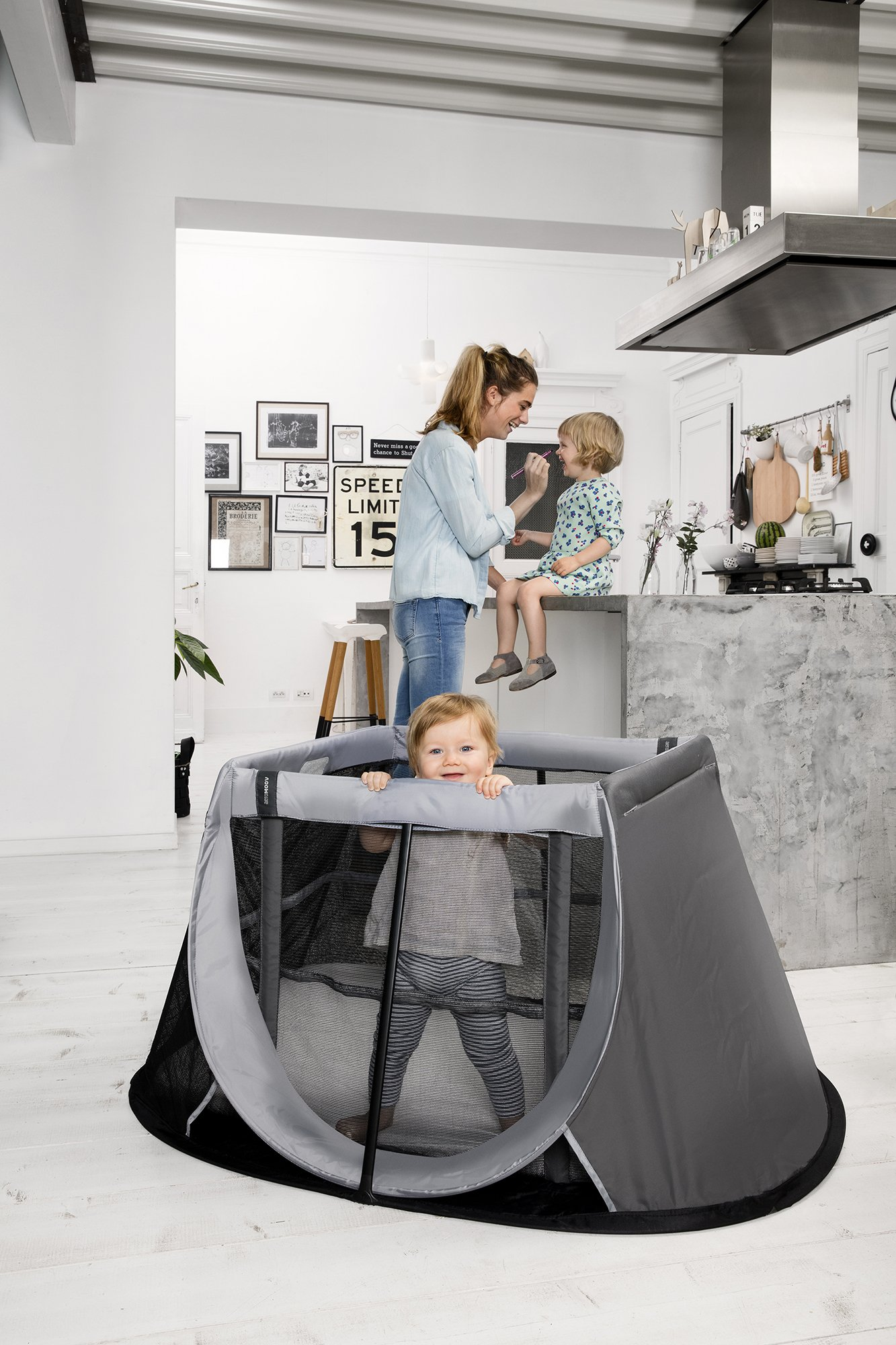 AEROMOOV - Instant Travel Bed - Allows Your Child to take a nap Wherever You are - Light and Compact - Stone Grey AeroMoov COMPACT AND LIGHT: No more carrying a heavy and bulky travel bed! The AeroMoov Instant Travel Bed weighs less than 5kg and is easy to store thanks to its slim and elegant storage bag. TO BE TAKEN EVERYWHERE: At Grandma and Grandpa's, on the beach or in your garden, allow your little one to take a pleasant nap or play, without ever losing sight of him thanks to the transparent sides. FAST ASSEMBLY AND STORAGE: Installing your Instant Travel Bed becomes child's play. Mount and dismantle it in just 2 seconds. 2