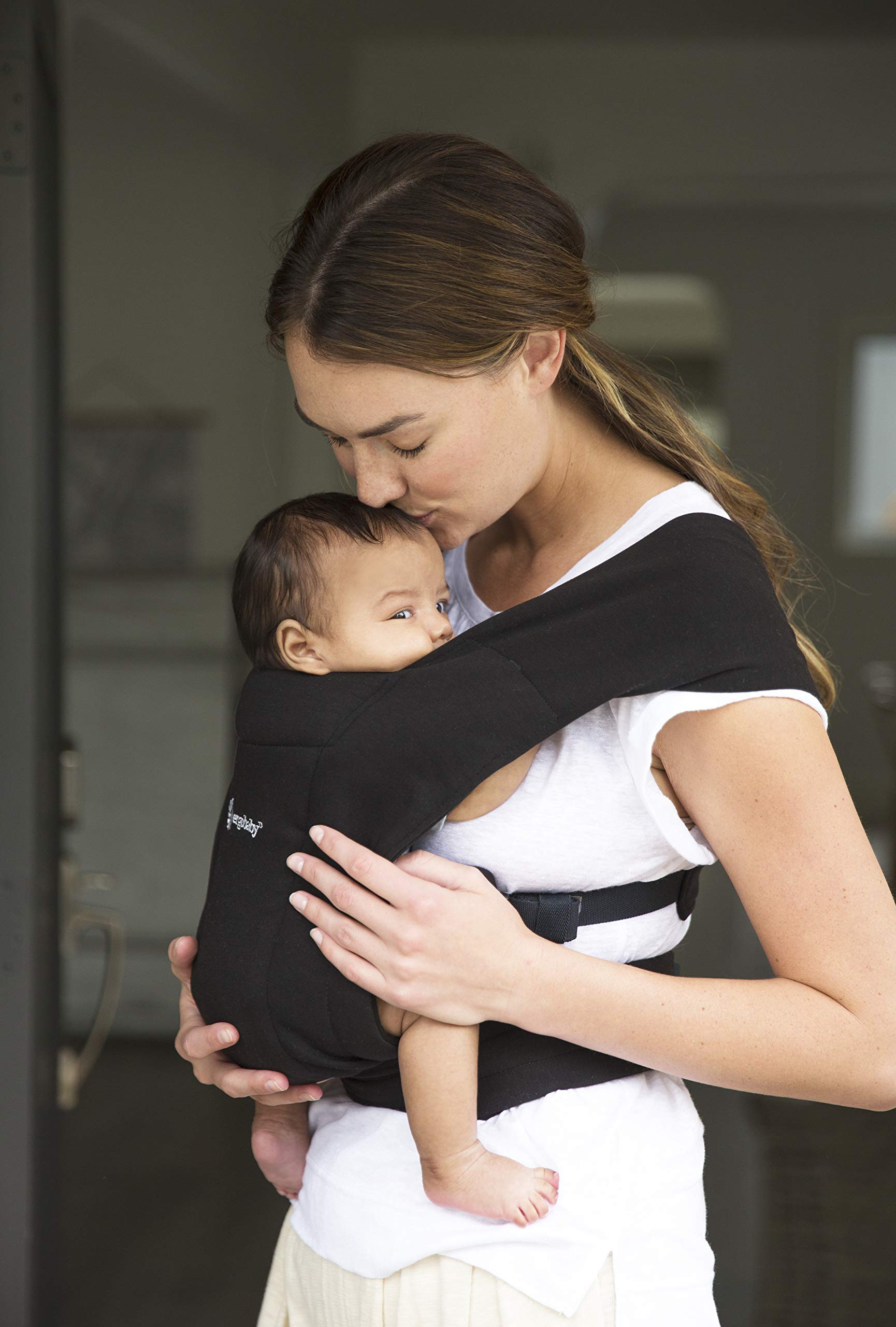 """ErgobabyEmbraceBaby Carrier for Newborns from Birth with Head Support, Extra Soft and Ergonomic (Pure Black) Ergobaby ERGONOMIC BABY CARRIER FROM BIRTH - Carry your newborn baby (3.2 - 11.3kg) snuggled close to you. The baby carrier supports the ergonomic frog-leg position (""""M"""" shape position) of the baby. NEW - The Ergobaby Embrace 2-position Carrier has been specially developed for newborns and babies. A baby carry system for quick and easy use. ULTRA-LIGHT & SUPER SOFT - Less material against the child and open-sided to allow good air circulation. Made from super soft jersey fabric, Oeko-Tex100 certified. Lightweight carrier (approx. 480g). 3"""