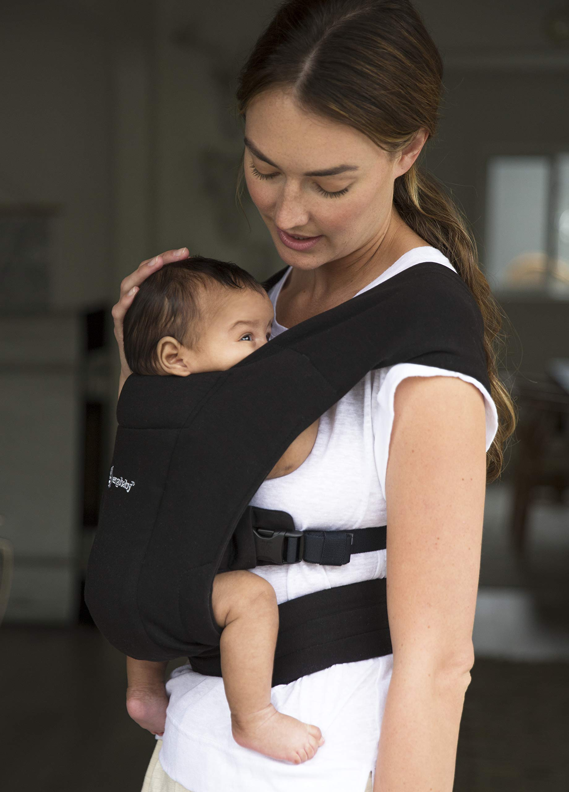 """ErgobabyEmbraceBaby Carrier for Newborns from Birth with Head Support, Extra Soft and Ergonomic (Pure Black) Ergobaby ERGONOMIC BABY CARRIER FROM BIRTH - Carry your newborn baby (3.2 - 11.3kg) snuggled close to you. The baby carrier supports the ergonomic frog-leg position (""""M"""" shape position) of the baby. NEW - The Ergobaby Embrace 2-position Carrier has been specially developed for newborns and babies. A baby carry system for quick and easy use. ULTRA-LIGHT & SUPER SOFT - Less material against the child and open-sided to allow good air circulation. Made from super soft jersey fabric, Oeko-Tex100 certified. Lightweight carrier (approx. 480g). 5"""
