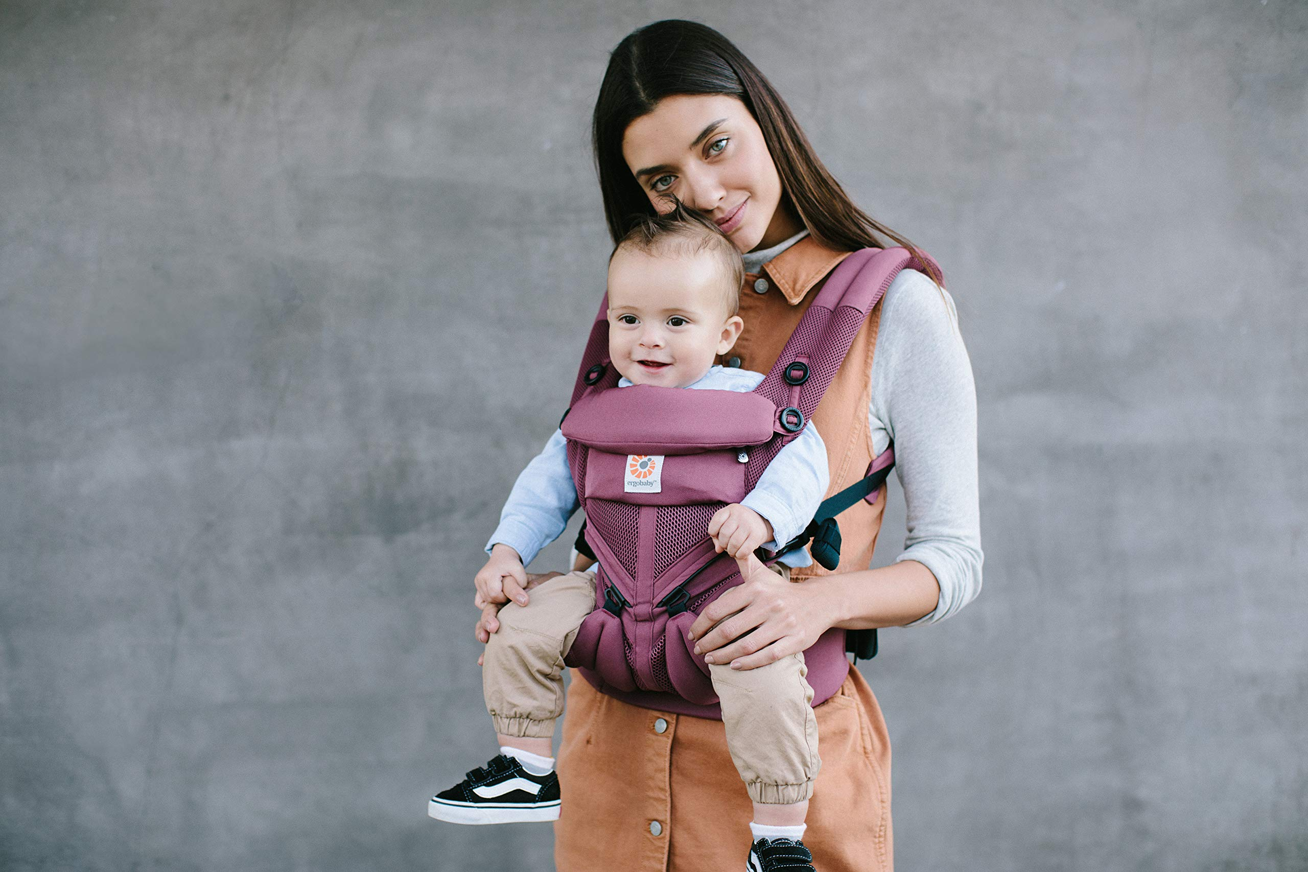 Ergobaby Baby Carrier for Newborn to Toddler, 4-Position Omni 360 Cool Air Plum, Breathable Ergonomic Child Carrier & Backpack Ergobaby BABY CARRIER FOR NEWBORN - Adapts to your growing baby from birth to toddler (7-45lbs). 4 carry positions: front-inward, back, hip, and front-outward. A Baby hood for sun protection (UPF 50+) & privacy for sleeping or breastfeeding is included. COMFORT - Exceptional lower back comfort with padded lumbar support waist belt & extra padded shoulder straps with the option to wear 2 ways: crossed or backpack style. Waist belt can be worn high or low to maximize comfort. COOL & BREATHABLE - Our Cool Air Mesh baby carriers are made with soft and durable mesh fabric that provides our renowned ergonomic support for baby while allowing for ultimate breathability and airflow 8