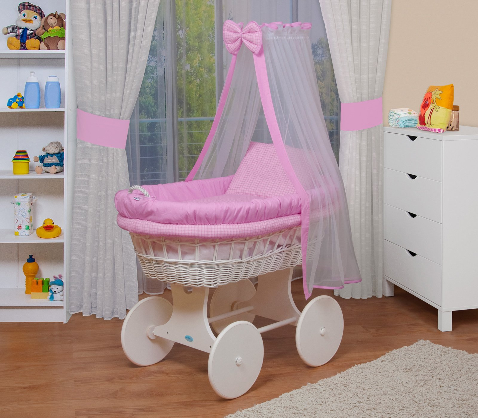 WALDIN Baby wicker cradle, Moses basket,18 models available,white painted stand/wheels,textile colour pink  For more models and colours click on WALDIN under the title Bassinet complete with bedding and stand Certified to safety standard EN 1130-1/2 1