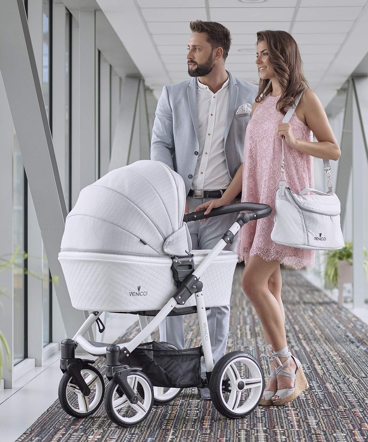 Venicci Pure 3-in-1 Travel System - Stone Grey - with Carrycot + Car Seat + Changing Bag + Apron + Raincover + Mosquito Net + 5-Point Harness and UV 50+ Fabric + Car Seat Adapters + Cup Holder  3 in 1 Travel System with included Group 0+ Car Seat Suitable for your baby from birth until 36 months 5-point harness to enhance the safety of your child 5