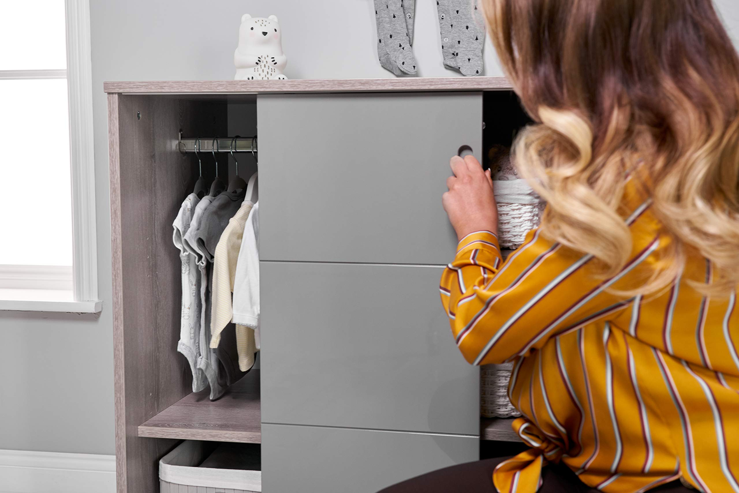 Obaby Madrid Storage Unit, Lunar Obaby Left side offers the option of a hanging rail and shelf or three shelves Right side has 3 fixed shelves Option to add the removable changing top to turn into a changing unit 7