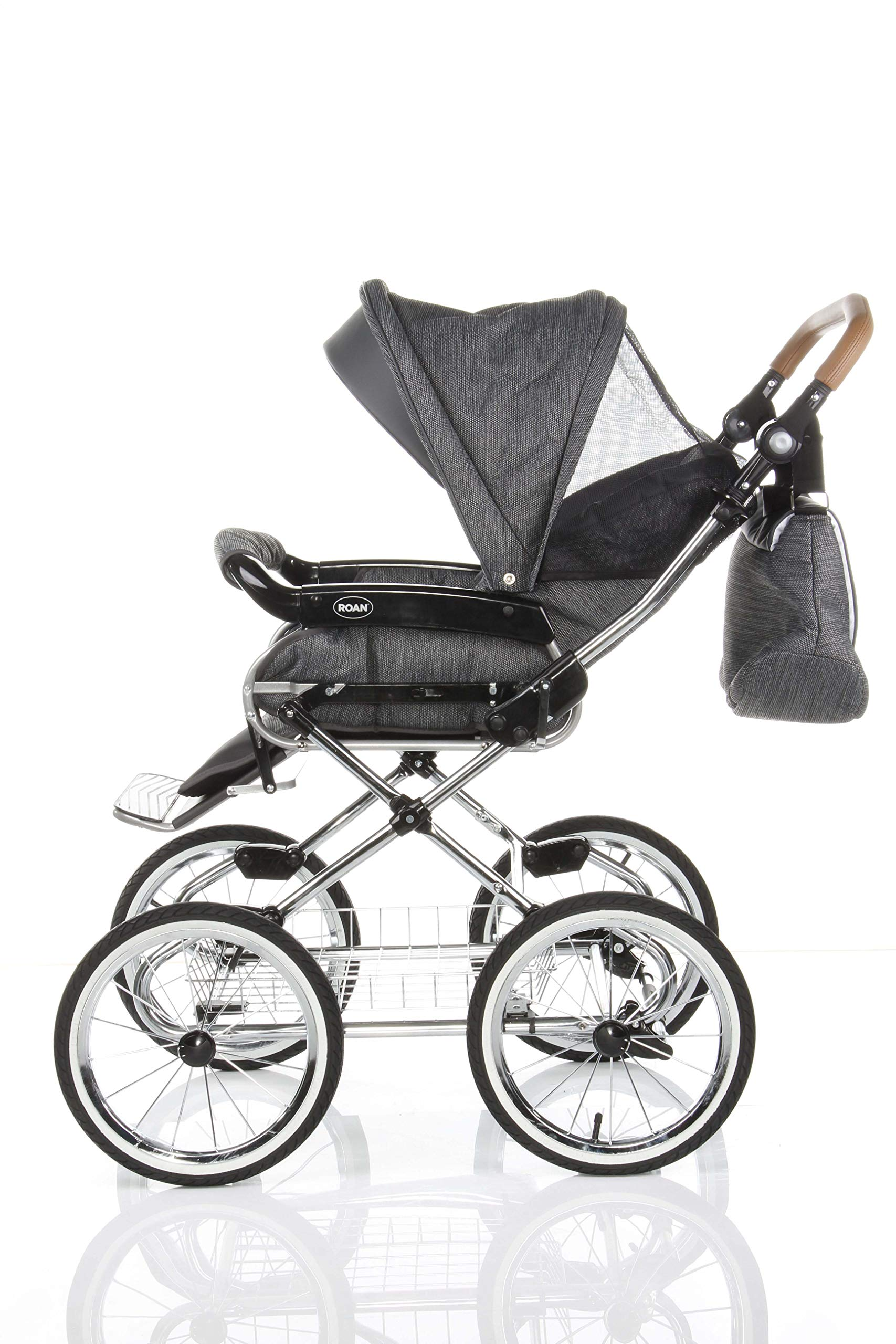 Children's Pram Buggy Stroller Combination Car seat Classic Retro Baby Carrier ROAN Emma (E-81 Dark Grey Melange-Grey Leather, 2IN1) JUNAMA Frame / wheels Sturdy and lightweight aluminum frame construction with folding function 1-click system for easy assembly and disassembly Practical carrying handle for easy storage of the folded frame Wheels for inflating (14 inch) removable wheels Brake system with central brake Height-adjustable push handle - 10-fold matching shopping basket Dimensions folded with wheels: 86 x 60 x 40 cm folded without wheels: 76 x 60 x 26 cm Total height of the stroller to hood top: 106 cm Height of the tub from the ground: 60 cm Wheelbase External dimensions: 80x 58 cm Variable height of the push handle: 77- 119 cm Weight of the frame incl. Wheels and carrying bag 15 kg Carrycot Length and width of carrycot outside: 88 x 42 cm Carrying bag length and width inside: 76 x 35 cm Sturdy plastic tub with comfortable mattress and side protection Ventilation slots on the plastic tub The baby car seat 0-13 kg Maxi-Cosi in black incl. Adapter 6