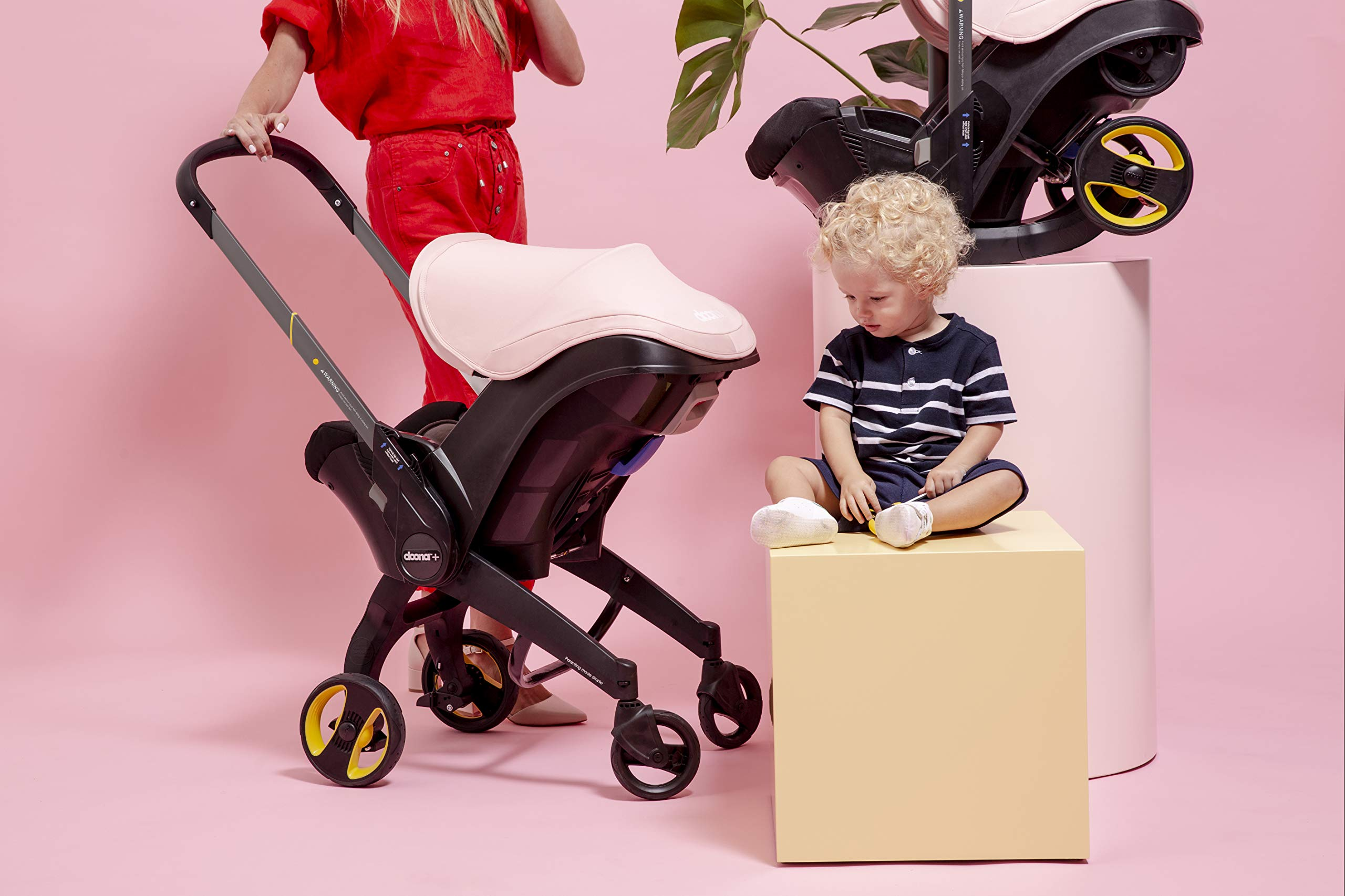 Doona Car Seat and Pram, Blush Pink, Revolutionary 0+ Car Seat that Folds Between Car Seat & Pram in Seconds, ISOFIX Base Available. Car Seat H60cm x W44cm, Pram H99cm x 82cm. Perfect for Travelling Doona  7