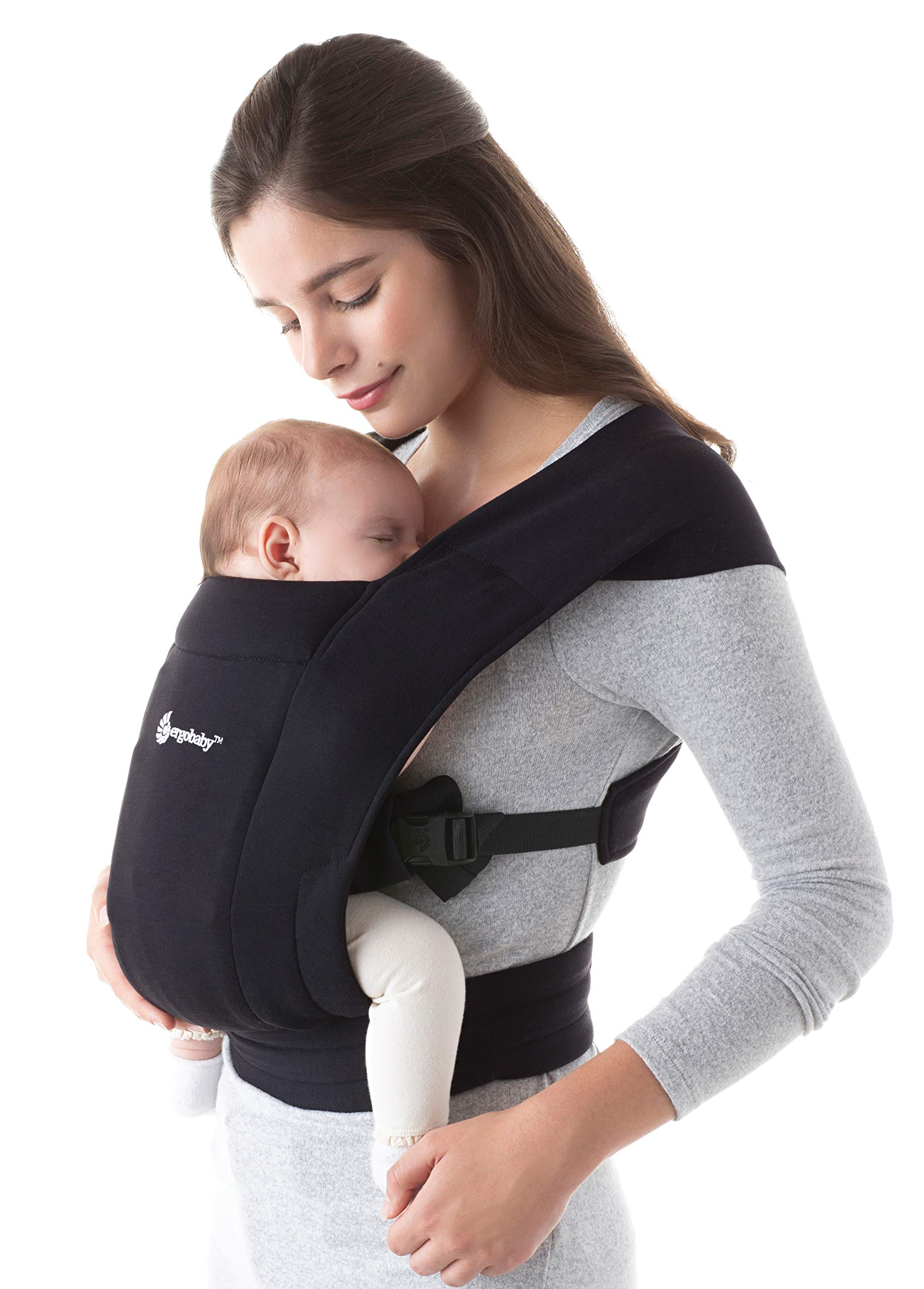"""ErgobabyEmbraceBaby Carrier for Newborns from Birth with Head Support, Extra Soft and Ergonomic (Pure Black) Ergobaby ERGONOMIC BABY CARRIER FROM BIRTH - Carry your newborn baby (3.2 - 11.3kg) snuggled close to you. The baby carrier supports the ergonomic frog-leg position (""""M"""" shape position) of the baby. NEW - The Ergobaby Embrace 2-position Carrier has been specially developed for newborns and babies. A baby carry system for quick and easy use. ULTRA-LIGHT & SUPER SOFT - Less material against the child and open-sided to allow good air circulation. Made from super soft jersey fabric, Oeko-Tex100 certified. Lightweight carrier (approx. 480g). 1"""