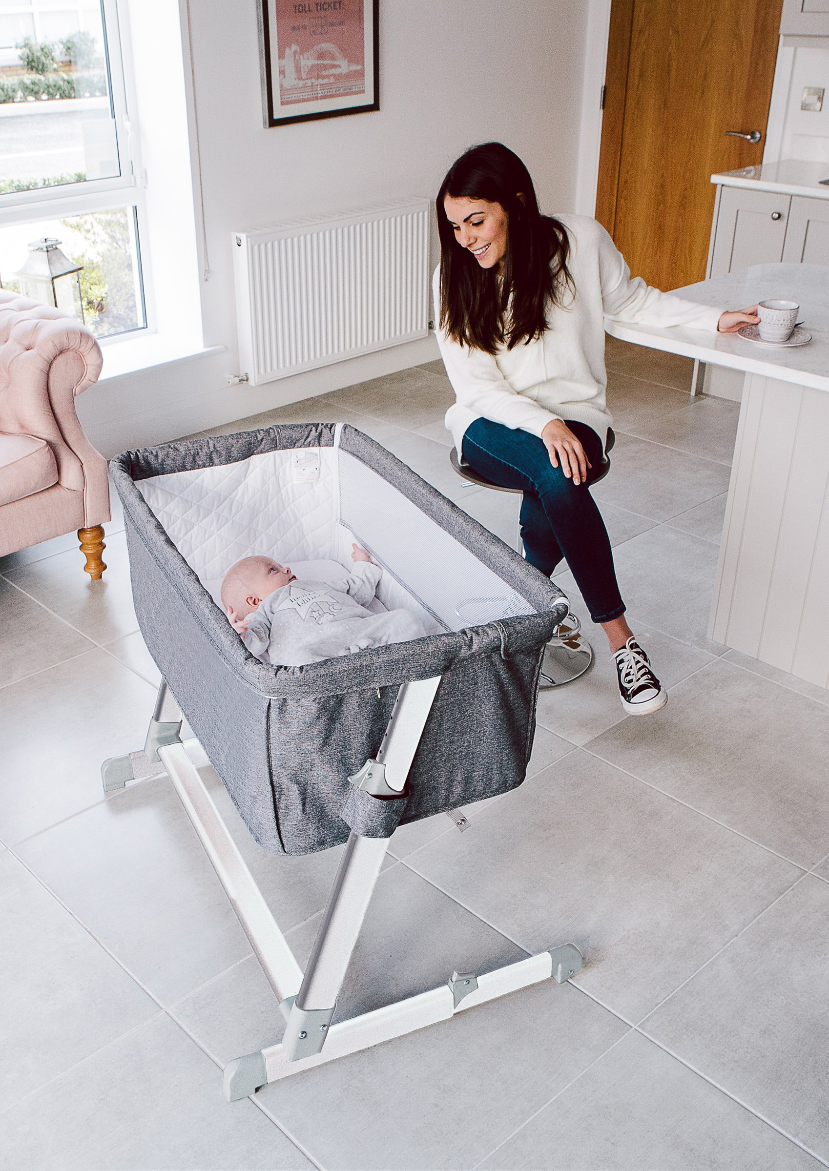Babylo Cozi Sleeper  Complete with 2 Free Sheets worth £25 Pounds. Removable lining for easy cleaning. Storage Bag Included. European & UK Standard EN1130. Free from Chemicals.  Mattress Fatigue Test BS1877 Certified. Comes fitted with 2 wheels for easy manoeuvrability between rooms. Zip down side panel when fixing to the parents' bed for side-sleeping. Multi-height positions, individually adjustable on each side. Can be set inclined to help with congested breathing and reflux. Use from birth to 9kgs. Stop using when child can sit, kneel or pull themselves up unaided.  Fits both frame and divan beds as the design allows the crib to move flush with bed. Two fastening clip-on straps to hold crib snug against bed. As baby grows you can move it away from the bed and use as a normal crib. Removable and washable lining. Soft removable mattress included. 2 free sheets included. Soft quilted sides with mesh for visibility and ventilation. Easy manoeuvrability, assembly and use. Mattress size 87lx46wx4d. Handy storage bag for transportation. 3