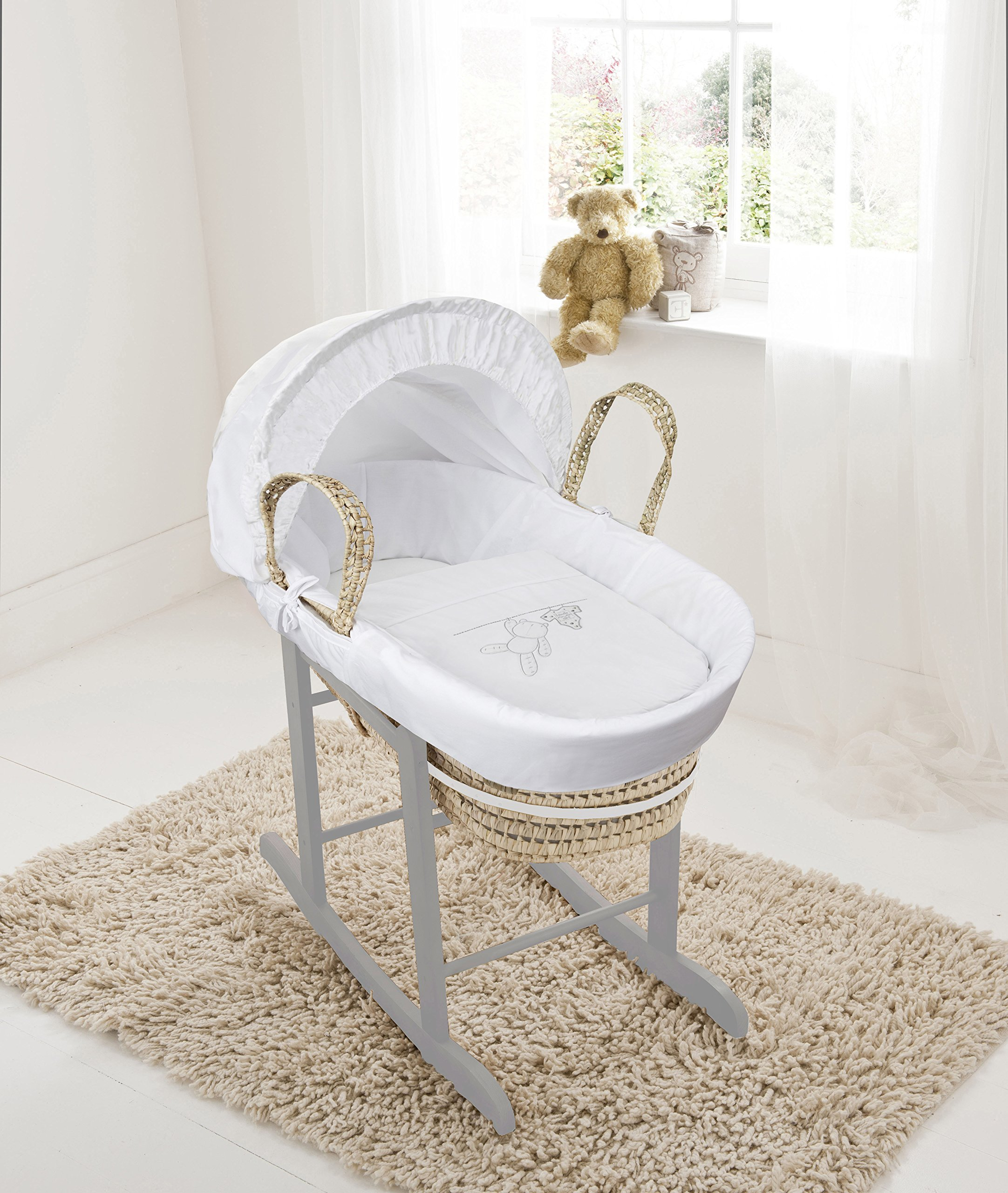 White Teddy Wash Day On Palm Moses Basket & Deluxe Dove Grey Rocking Stand Elegant Baby Suitable from newborn for up to 9kg, this Moses Basket uses Easy-care Poly Cotton with a soft padding surround Suitable from newborn to 9 months It also includes a comfortable mattress and an adjustable hood perfect to create a cosy sleeping space for your precious little one 1