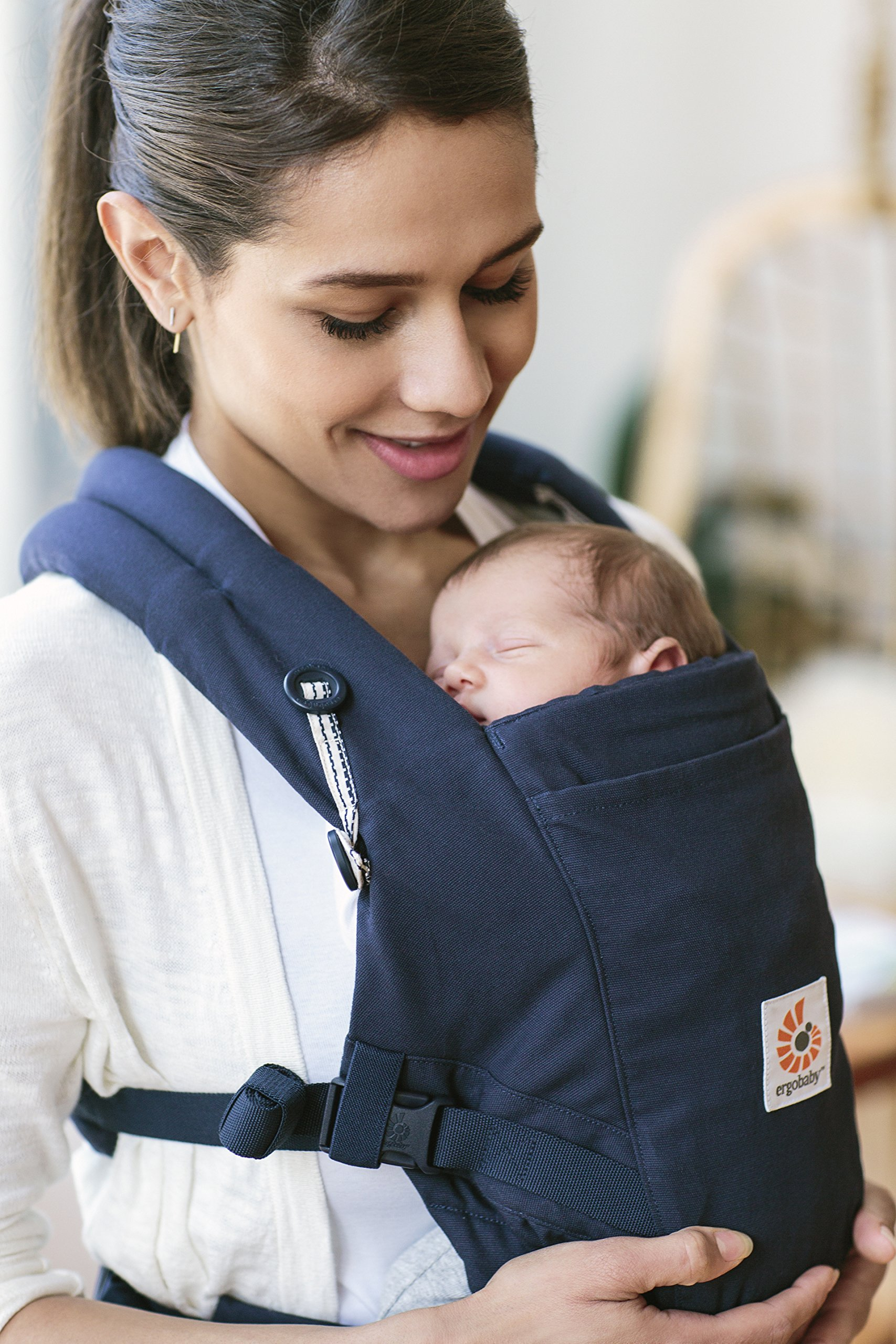 Ergobaby Baby Carrier for Newborn to Toddler, Admiral Blue Adapt 3-Position Ergonomic Child Carrier Backpack Ergobaby Carrier for newborns - The ergonomic bucket seat gradually adjusts to your growing baby, to ensure baby is seated in a natural frog-leg position (M-shape position) from newborn to toddler (3.2-20 kg / 7-45 lbs). NEW - Now with lumbar support. Long-wearing comfort for parents with even weight distribution between hips and shoulders. Lumbar support waistbelt that can be adjusted to the height of the carry position for extra, long-wearing comfort. 3 carry positions: front-inward, hip and back. The carrier has a padded, foldable head and neck support and a tuck-away baby hood for sun protection (UPF 50+) and privacy. It is possible to breastfeed in the carrier. 7