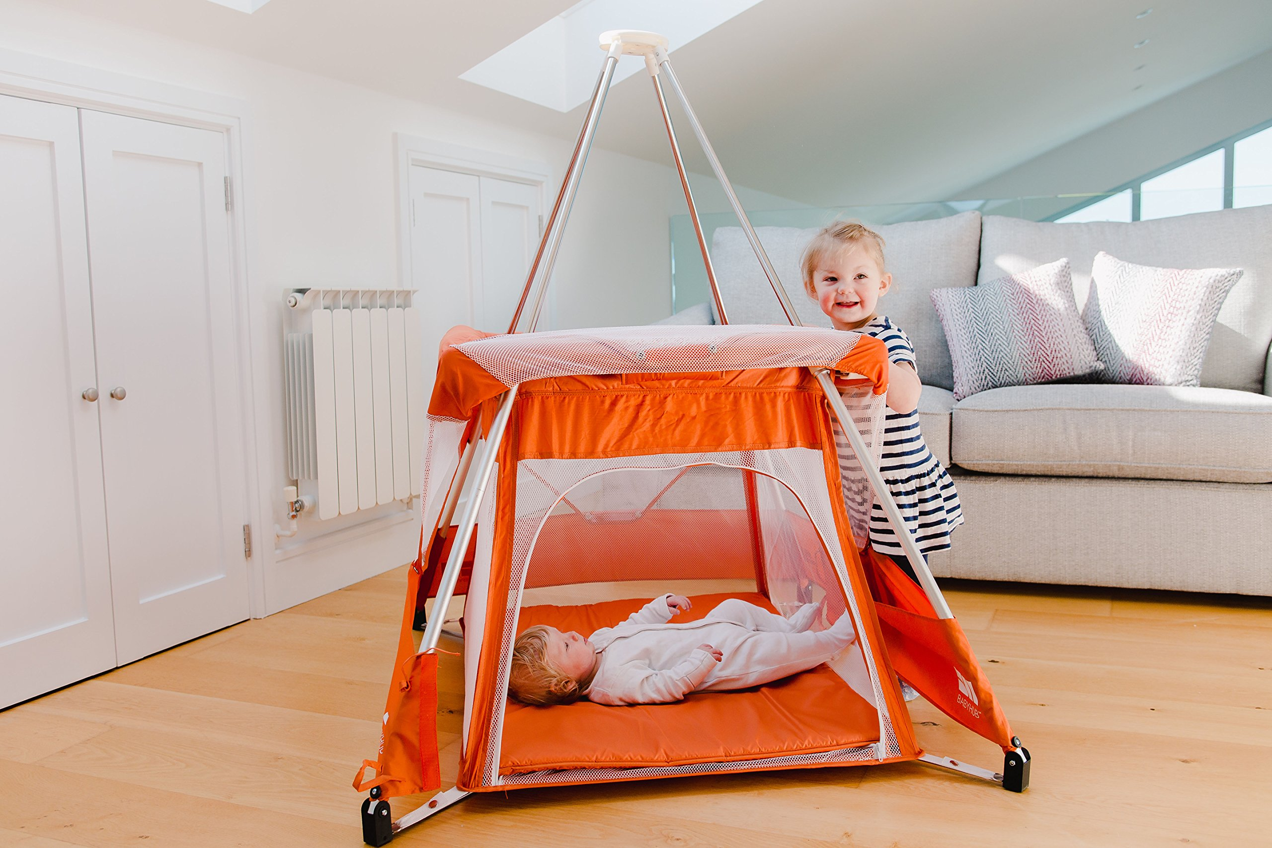 BabyHub SleepSpace Travel Cot with Mosquito Net, Orange BabyHub Three cots in one; use as a travel cot, mosquito proof space and reuse as a play tepee Includes extra mosquito net cover that can be securely in place Can be set up and moved even while holding a baby 3