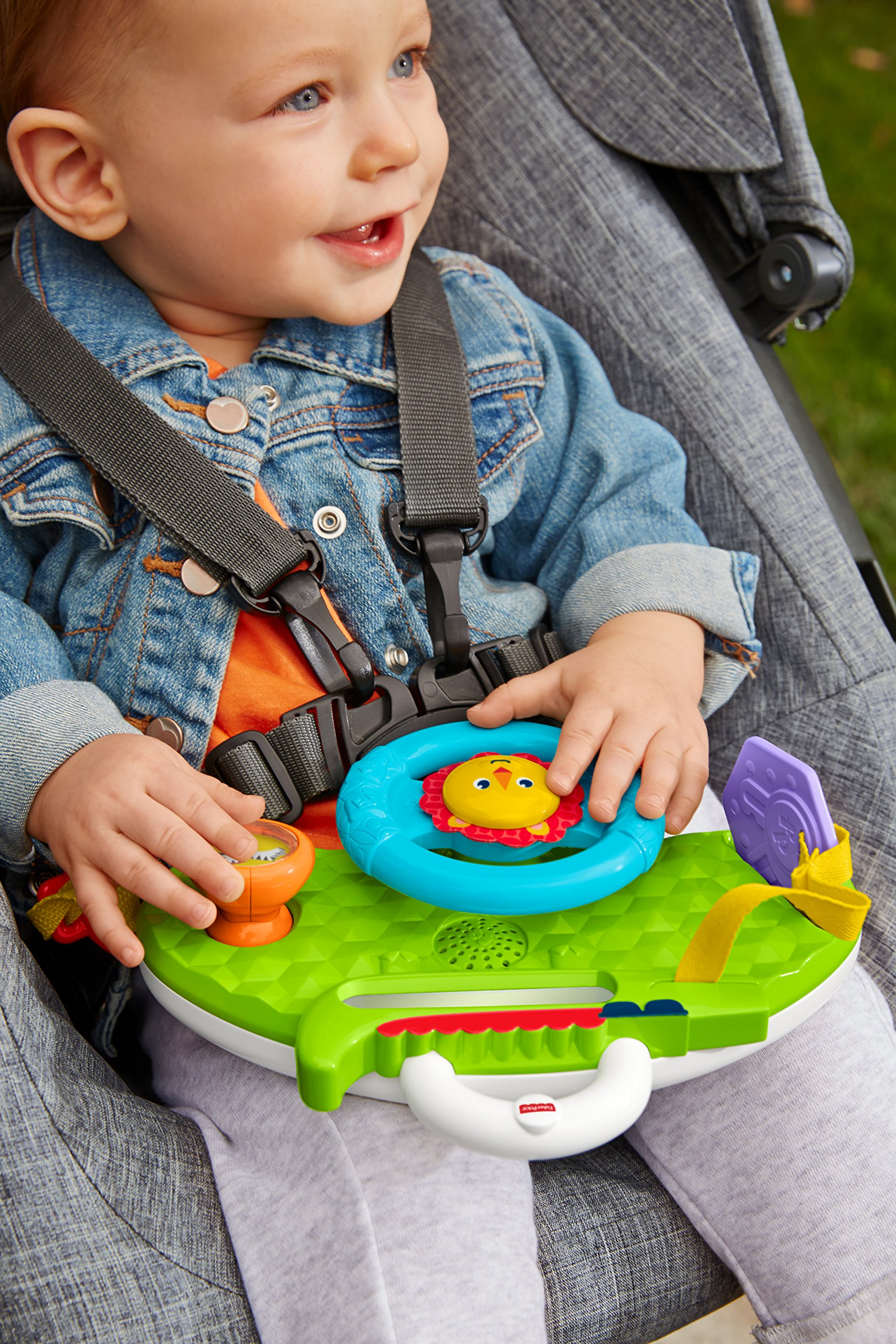 Fisher-Price Rolling and Strolling Dashboard, New-born Activity Toy with Music Sounds Fisher-Price  Attaches to stroller for playtime on the go  Turn the lion steering wheel to hear short songs  Push the lion's face for silly sound effects (Beep beep!) 5