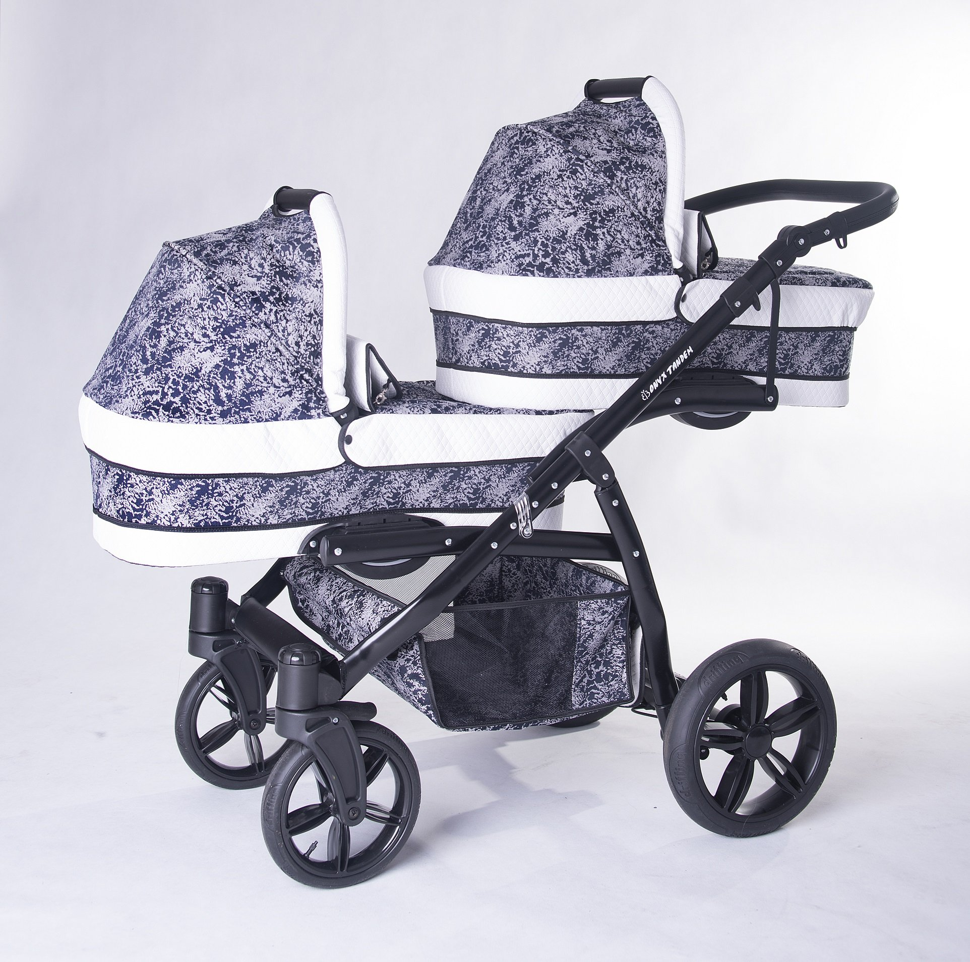Double pram for twins. 2 carrycots + 2 buggies + 2 car seats. Blue + white ecoleather. BBtwin Berber Carlo Directly from the factory, warranty and advice. Made un the EU according to the regulations EN1888 and ECE44/04. Colour blue and silver with whote ecoleather, chassis black. Includes 2 carrycots, 2 buggy seats, 2 car seats, bag, 2 footcovers, 2 rain covers, 2 mosquito nets, lower basket, Features: lightweight aluminium frame, easy bending, adjustable handlebar, central brake, lockable front swivel wheels, shock absorbers, each buggy can be instaled independently in both directions, carrycots with a mattress and a washable cover, backrest adjustable in various positions, safety bar and harness of 5 points 1
