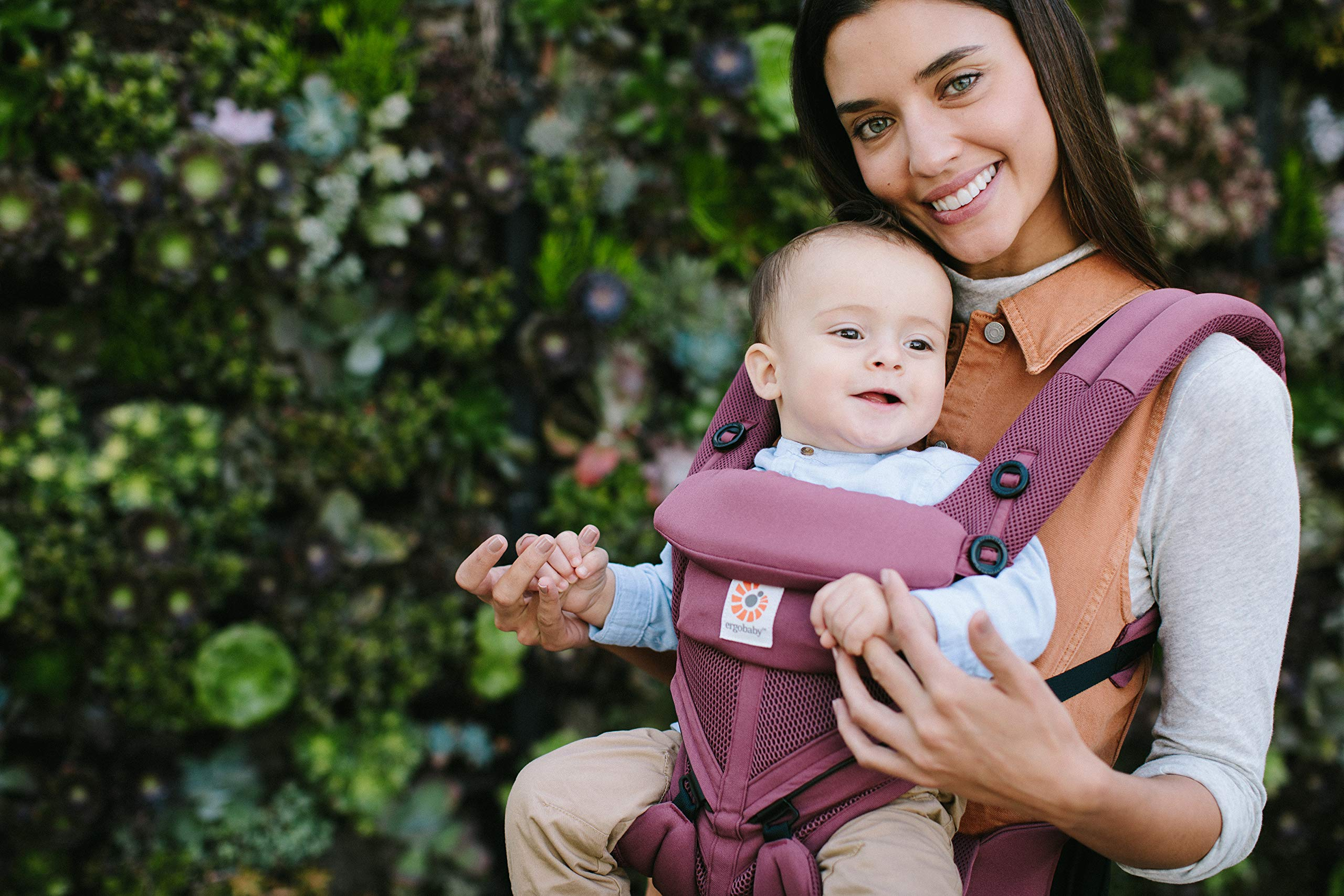 Ergobaby Baby Carrier for Newborn to Toddler, 4-Position Omni 360 Cool Air Plum, Breathable Ergonomic Child Carrier & Backpack Ergobaby BABY CARRIER FOR NEWBORN - Adapts to your growing baby from birth to toddler (7-45lbs). 4 carry positions: front-inward, back, hip, and front-outward. A Baby hood for sun protection (UPF 50+) & privacy for sleeping or breastfeeding is included. COMFORT - Exceptional lower back comfort with padded lumbar support waist belt & extra padded shoulder straps with the option to wear 2 ways: crossed or backpack style. Waist belt can be worn high or low to maximize comfort. COOL & BREATHABLE - Our Cool Air Mesh baby carriers are made with soft and durable mesh fabric that provides our renowned ergonomic support for baby while allowing for ultimate breathability and airflow 4