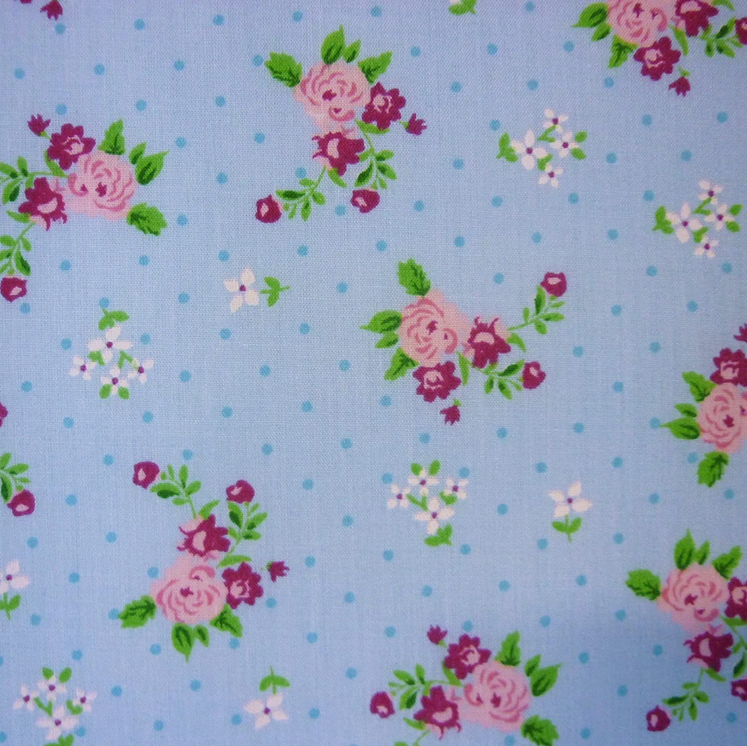 blue polka dot polycotton fabric with roses and small flower print