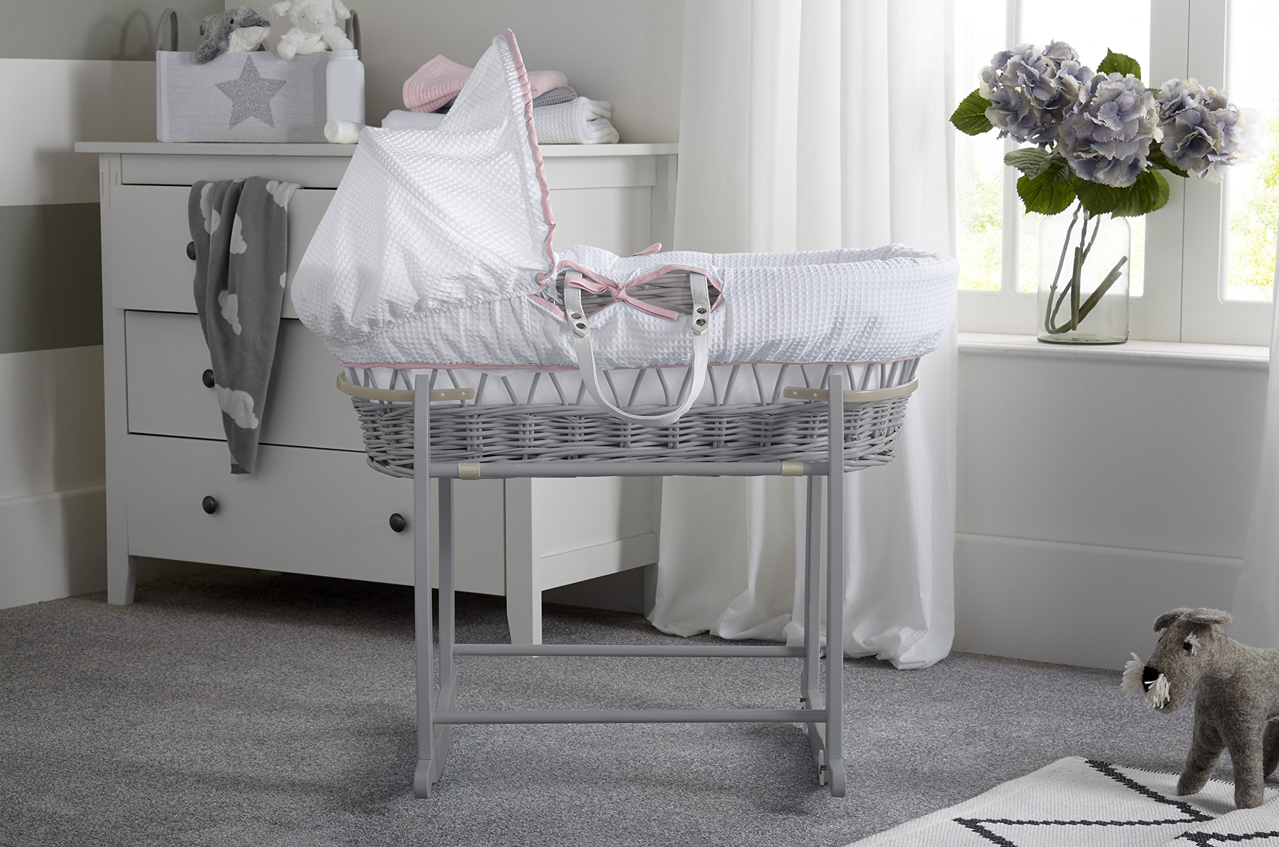 Clair de Lune Wicker Moses Basket, Pink/Grey, Over The Moon Clair de Lune Made from 100% super soft cotton fabric, featuring star prints and a sleepy moon with crocheted cloud appliqué for the perfect finishing touch. Comes complete with a removable, adjustable hood, padded liner, coverlet, 2 carry handles, and a mattress. *stand sold separately. Adjustable hood that's perfect for creating a cosy sleeping space for your precious little one. 2