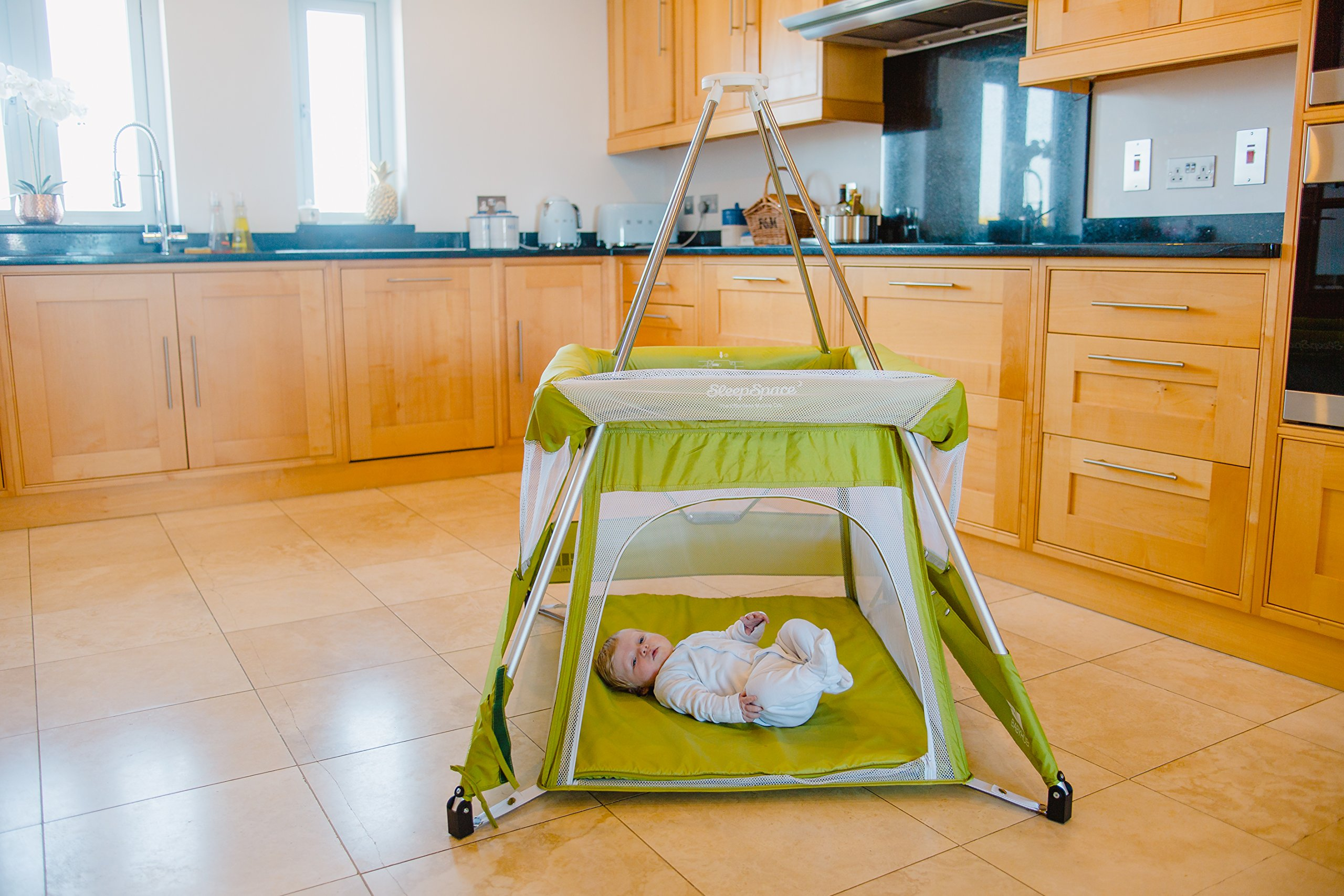 BabyHub SleepSpace Travel Cot with Mosquito Net, Green BabyHub Three cots in one; use as a travel cot, mosquito proof space and reuse as a play tepee Includes cotton canvas tepee cover Can be set up and moved even while holding a baby. Dimensions Open - L 116cm x W 960cm x H 122cm (when opened). Dimensions Closed - 83cm H x 22cm x 42cm (in bag) 4