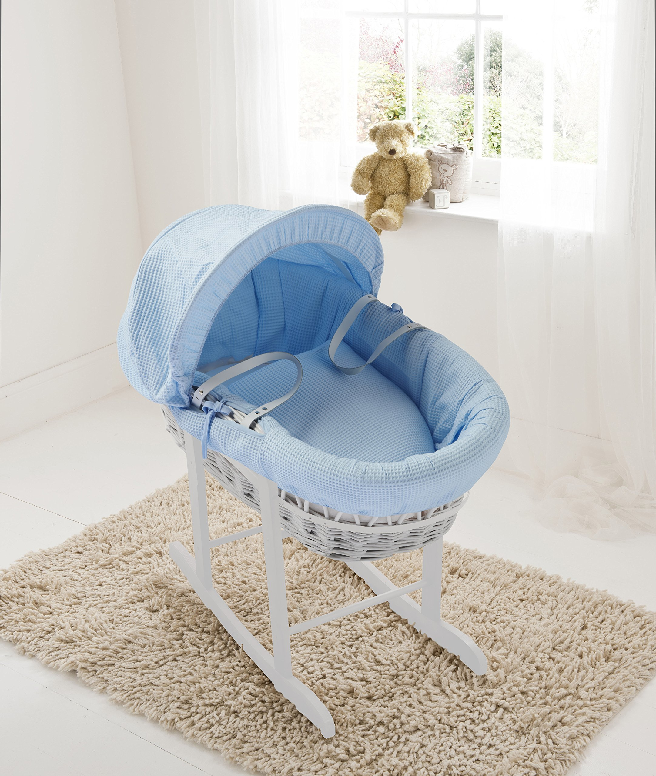Blue Waffle White Wicker Moses Basket & Deluxe White Rocking Stand Elegant Baby Suitable from newborn for up to 9kg, this Moses Basket uses Easy-care Poly Cotton with a soft padding surround Suitable from newborn to 9 months It also includes a comfortable mattress and an adjustable hood perfect to create a cosy sleeping space for your precious little one 1