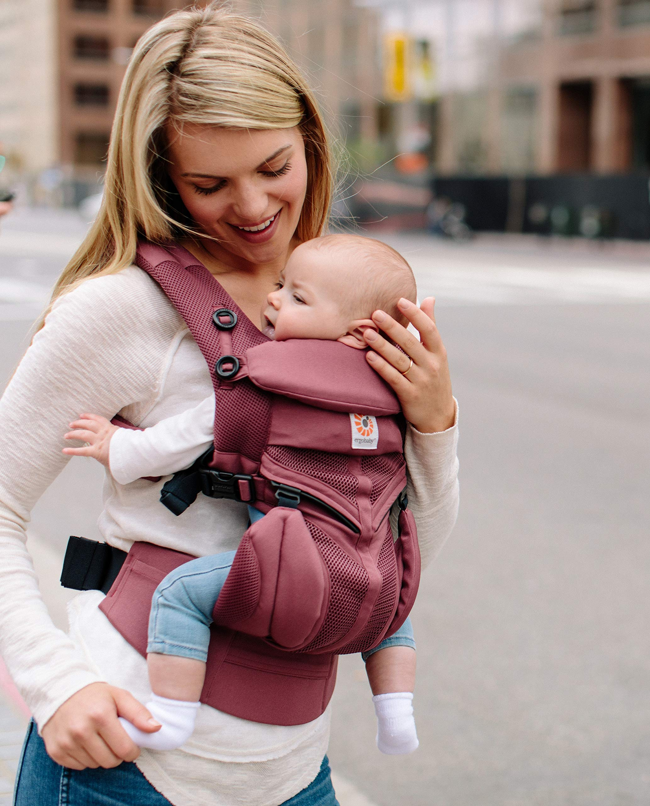 Ergobaby Baby Carrier for Newborn to Toddler, 4-Position Omni 360 Cool Air Plum, Breathable Ergonomic Child Carrier & Backpack Ergobaby BABY CARRIER FOR NEWBORN - Adapts to your growing baby from birth to toddler (7-45lbs). 4 carry positions: front-inward, back, hip, and front-outward. A Baby hood for sun protection (UPF 50+) & privacy for sleeping or breastfeeding is included. COMFORT - Exceptional lower back comfort with padded lumbar support waist belt & extra padded shoulder straps with the option to wear 2 ways: crossed or backpack style. Waist belt can be worn high or low to maximize comfort. COOL & BREATHABLE - Our Cool Air Mesh baby carriers are made with soft and durable mesh fabric that provides our renowned ergonomic support for baby while allowing for ultimate breathability and airflow 5