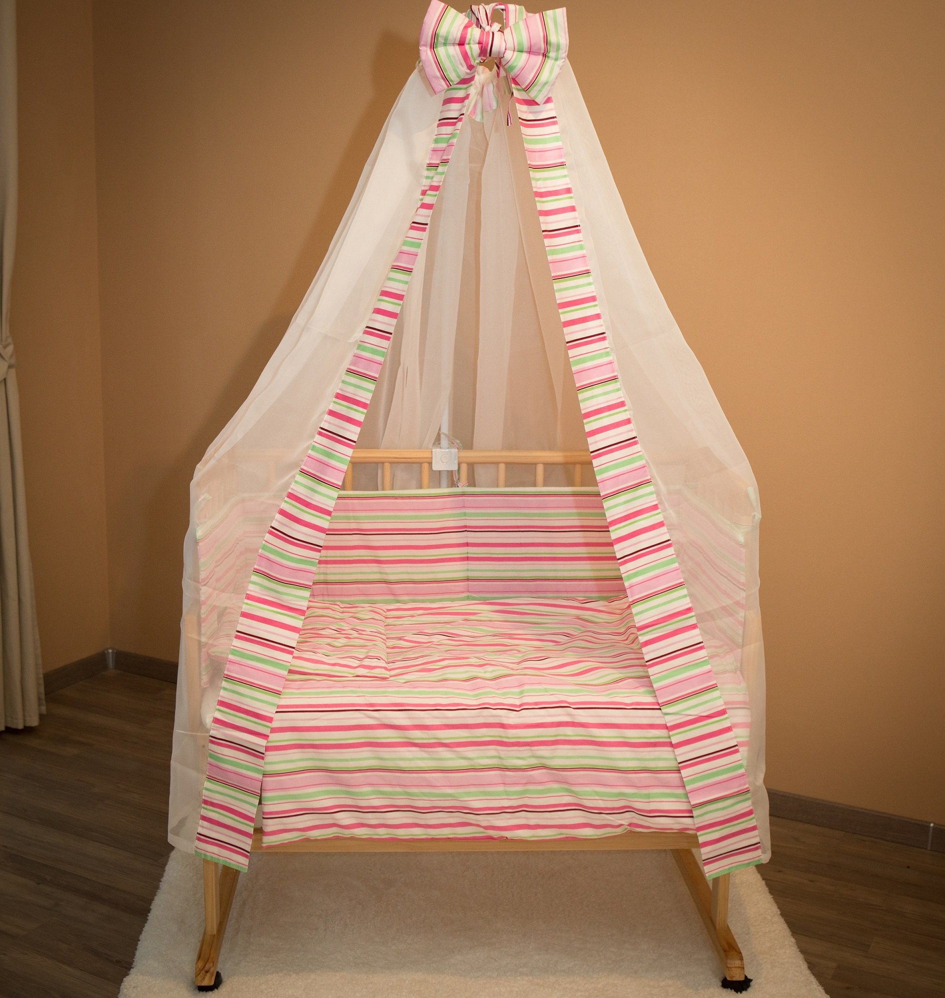 Bed side cot all inclusive 90x40cm, pink stripes Bambino World Main features:3 possible uses:Bed side cot (3 sides closed),Cot bed (4 sides closed),Child sofa;High quality pinewood;Height-adjustable duckboards;Inclusive bedlinen set, canopy and mattress; Bed side cot with large lying space 90 x 40 or 90 x 55cm (if you use the included additional board);Made of high-quality pinewood, clear-varnished with saliva-resistant toy´s paint with a high proportion of wax;Inclusive additional lateral part for use as a cot bed;Height-adjustable duckboards from 17 to 46cm to fit to the height of the parent´s bed; 4 movable castors, 2 with a brake;Overall dimensions 93 x 44/56 x 81cm; Accessories included in our offer:Mattress:High quality mattresses: soft foam polyurethane,Dimensions: 90 x (40+15)cm,Mattress cover: 100% cotton,Quilted on one side with washable fabric,Removable, machine washable at 60°C, 2