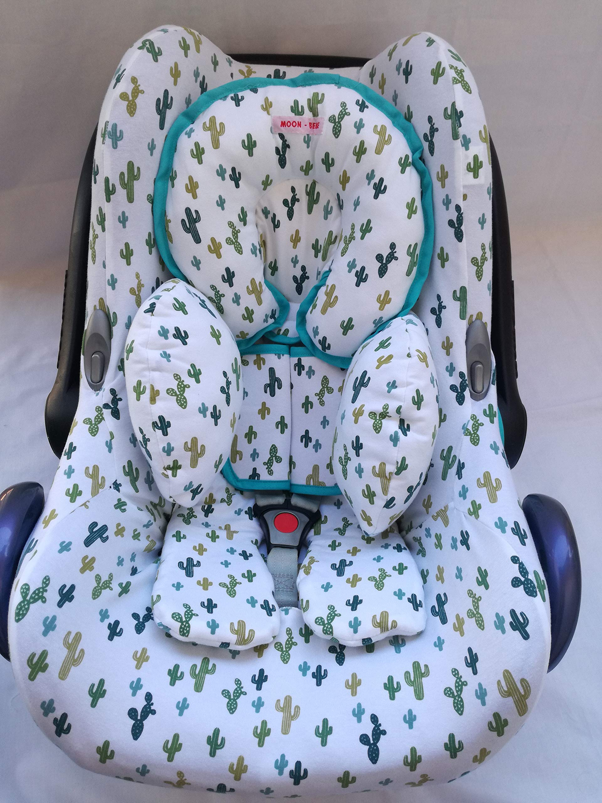 MOON.BEBE Cover Liner for Maxi COSI Cabrio Fix, Citi, Streety Fix, Jané Koos WHITE(GREEN CACTUS) Moon-bebe Quick and easy to put on thanks to its elasticated edges. Fits over the chair as standard, no need to remove the pre-existing cover from the manufacturer Manufactured in Spain. Does not include the Maxi Cosi Baby Carrier. The hood and the reducer are sold separately. Made of cotton, it does not irritate your baby's skin and provides optimal weather and comfort in the car seat. The cover prevents the chair from wear and tear, keeping it looking new for years 5