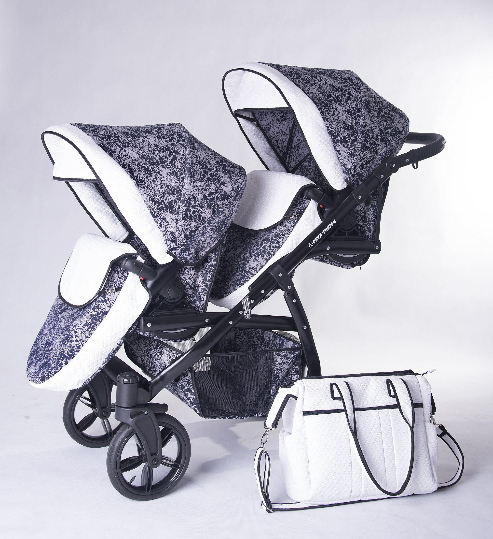 Double pram for twins. 2 carrycots + 2 buggies + 2 car seats. Blue + white ecoleather. BBtwin Berber Carlo Directly from the factory, warranty and advice. Made un the EU according to the regulations EN1888 and ECE44/04. Colour blue and silver with whote ecoleather, chassis black. Includes 2 carrycots, 2 buggy seats, 2 car seats, bag, 2 footcovers, 2 rain covers, 2 mosquito nets, lower basket, Features: lightweight aluminium frame, easy bending, adjustable handlebar, central brake, lockable front swivel wheels, shock absorbers, each buggy can be instaled independently in both directions, carrycots with a mattress and a washable cover, backrest adjustable in various positions, safety bar and harness of 5 points 2