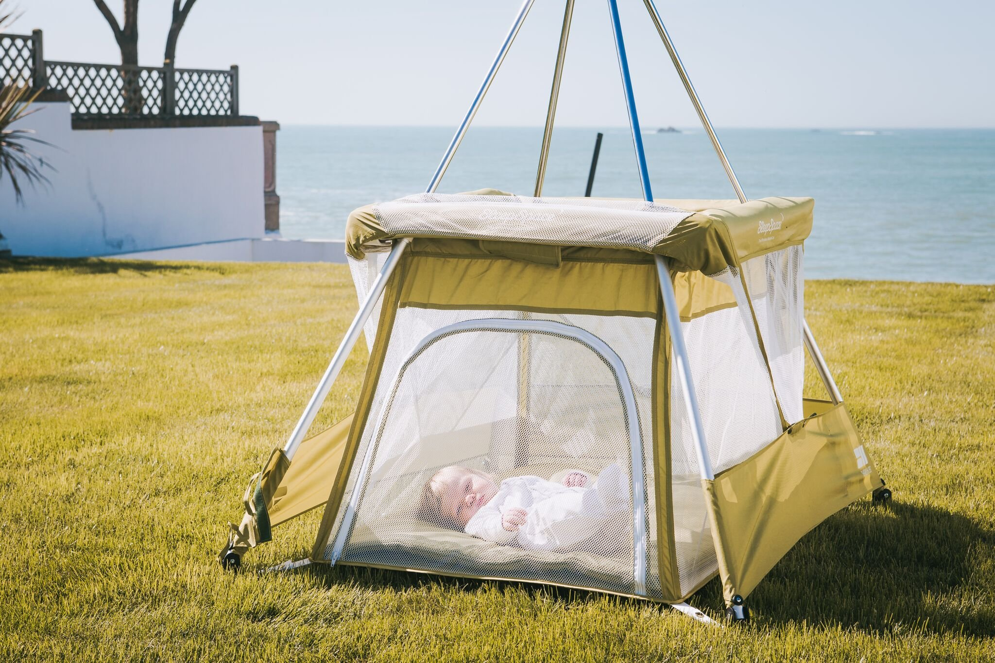 BabyHub SleepSpace Travel Cot with Mosquito Net, Green BabyHub Three cots in one; use as a travel cot, mosquito proof space and reuse as a play tepee Includes cotton canvas tepee cover Can be set up and moved even while holding a baby. Dimensions Open - L 116cm x W 960cm x H 122cm (when opened). Dimensions Closed - 83cm H x 22cm x 42cm (in bag) 5