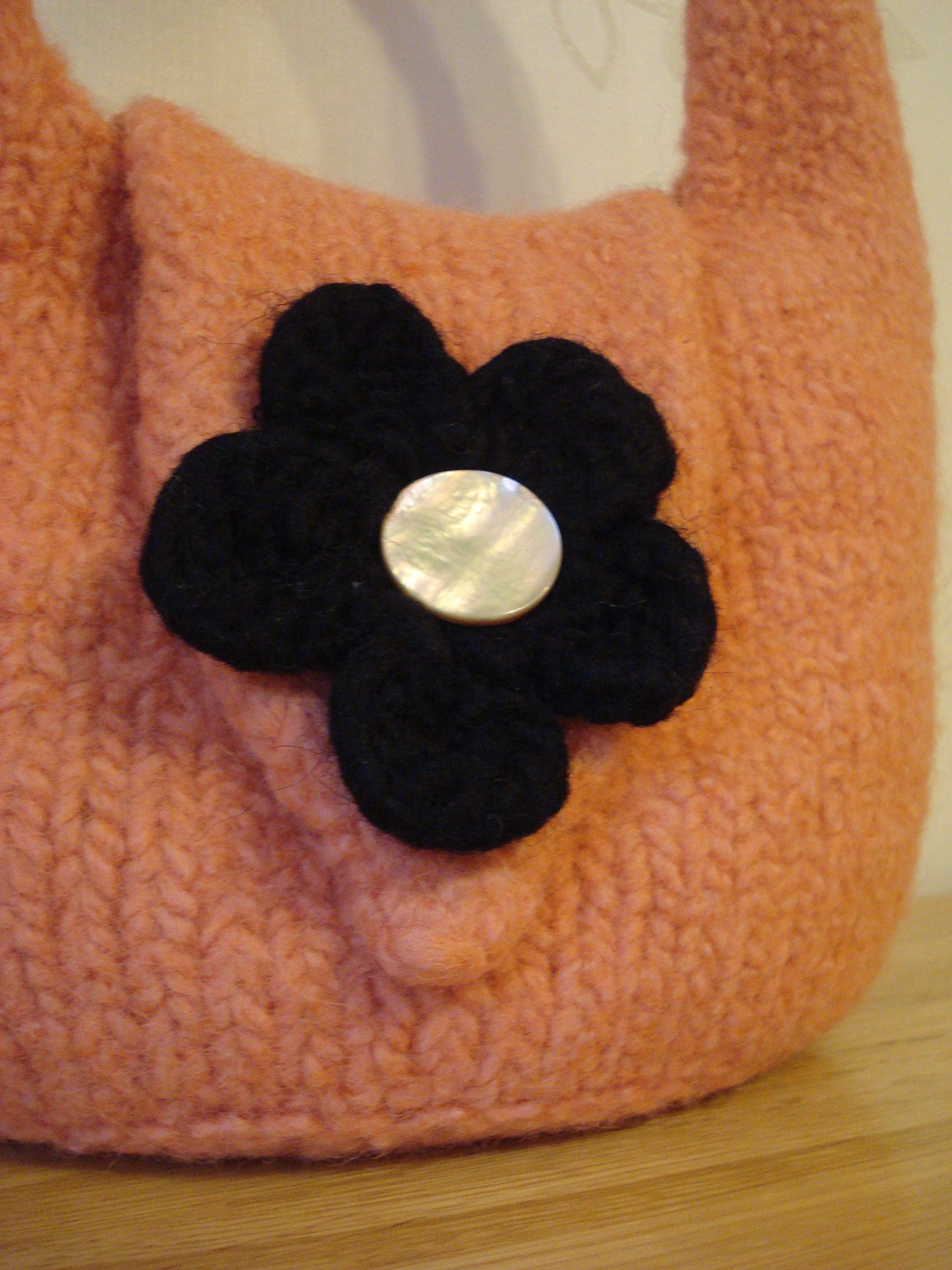 Small Hand Felted Bag in Orange With Button and Black Flower Front Fastening - handmade-bags