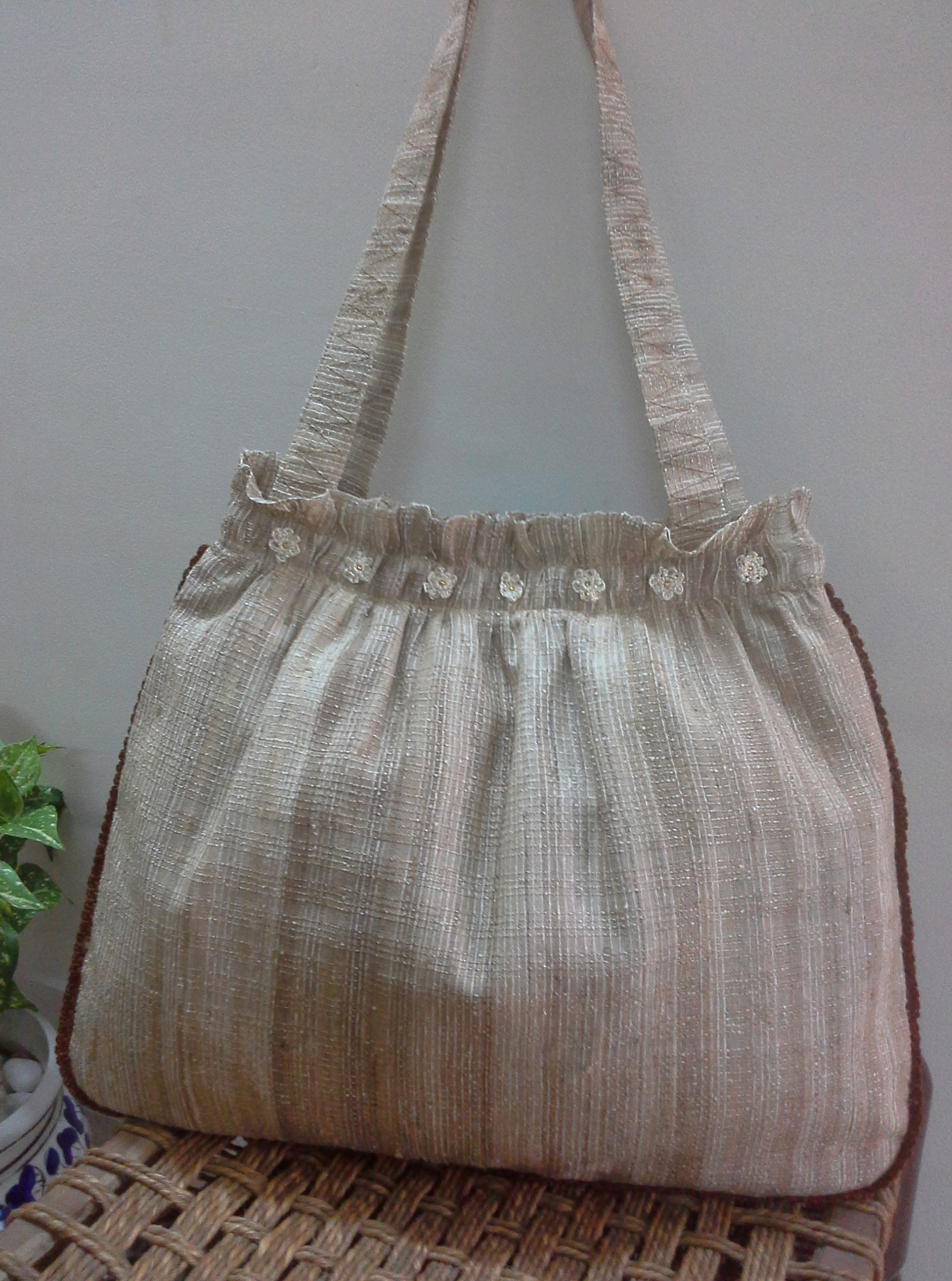 Panigha India Handmade Tote Bag made of Linen/Silk blended textured fabric in Natural color decorated with handmade crochet flowers and lace around the edge. - handmade-bags