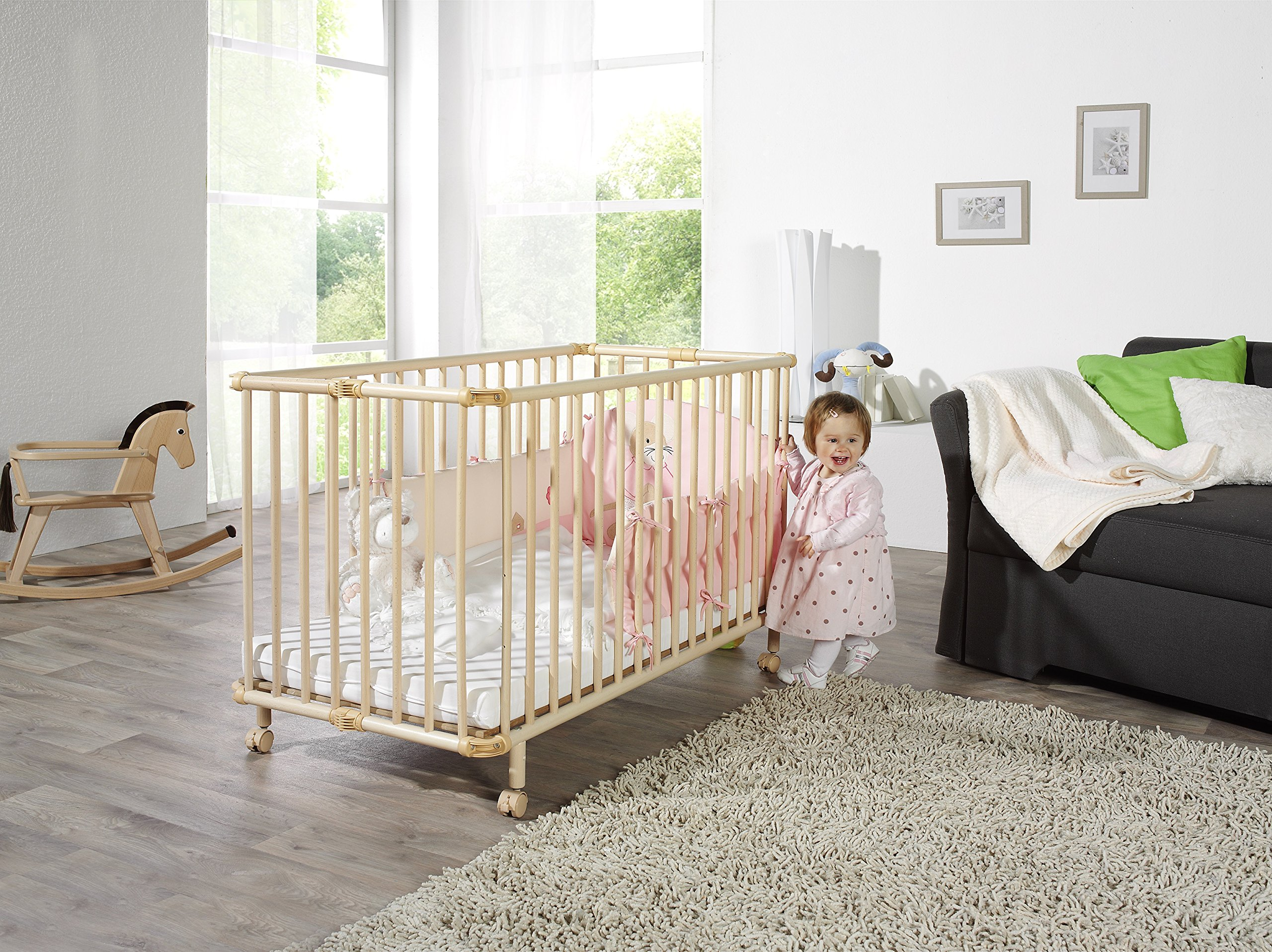Geuther - Folding Wooden Cot Mayla (60 x 120 cm, White)  Innovative fold away wooden cot Compact foldable design for easy storage Four lockable wheels for simple transportation around the home 3